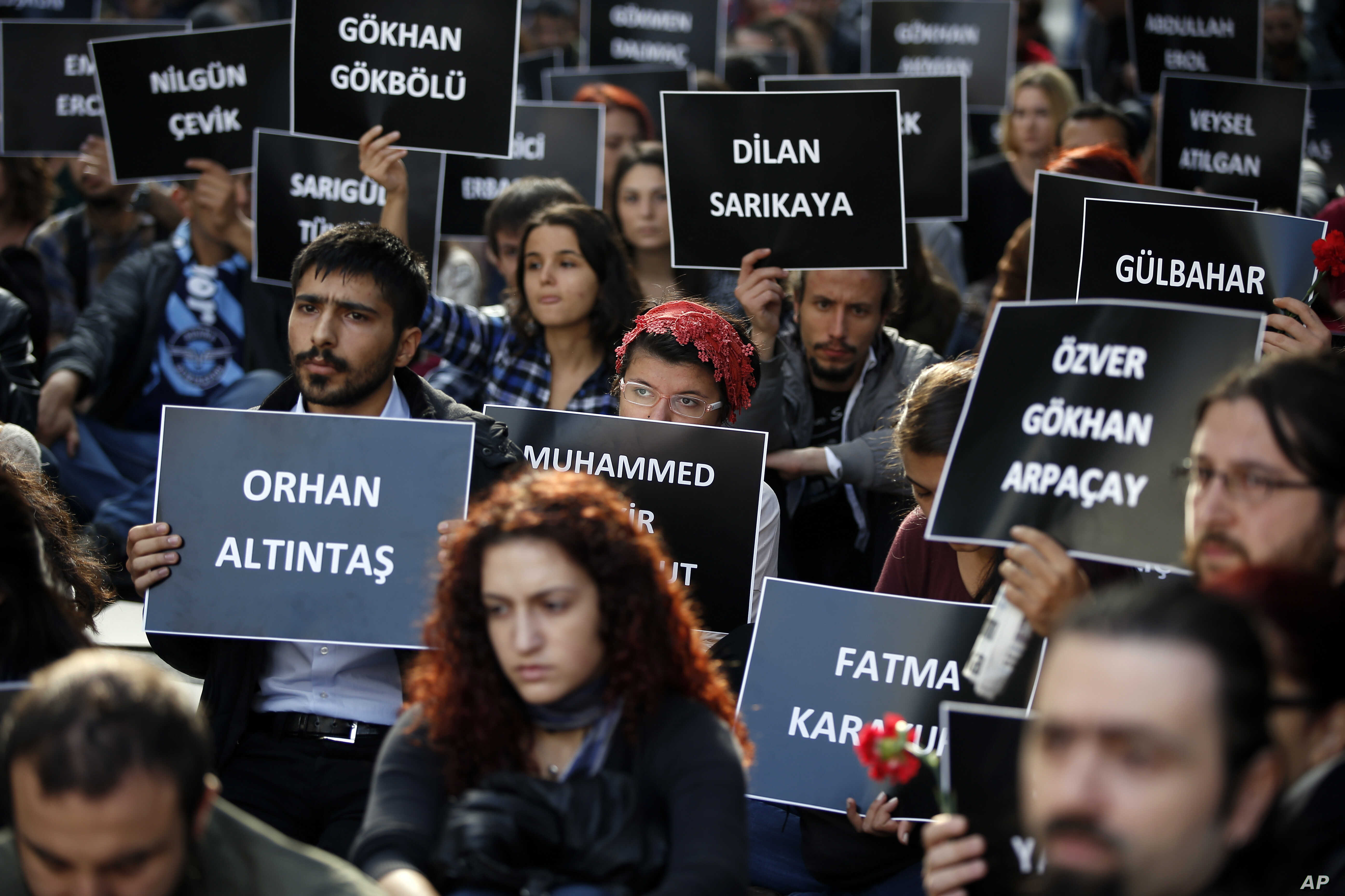 Students of Ankara University hold the placards with the names of those killed in the Oct. 10 deadly explosions in Ankara, during a sit-in protest in Turkey's capital city, Oct. 13, 2015.