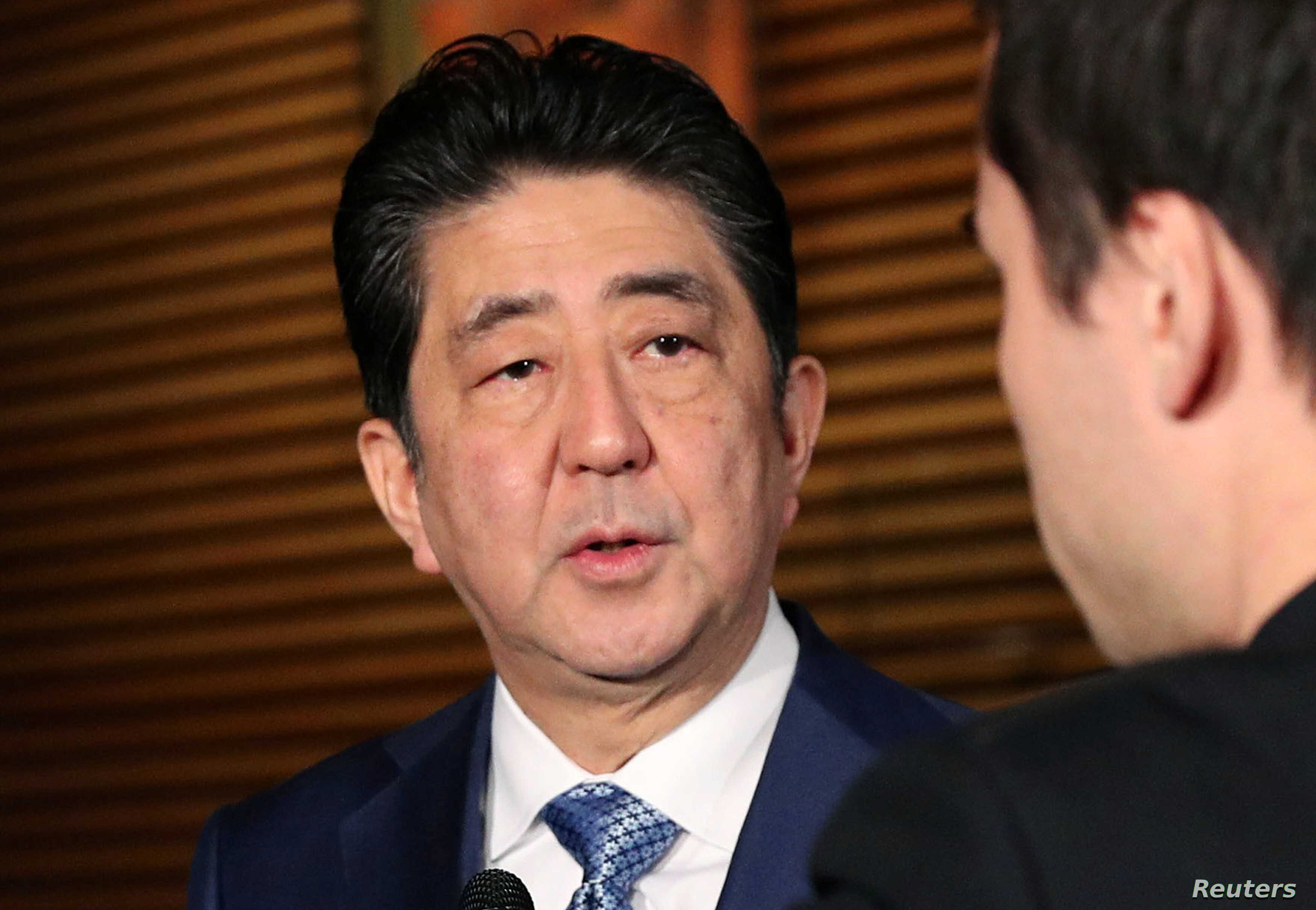 Japan's Prime Minister Shinzo Abe speaks to reporters about North Korea's missile launch, in Tokyo, Japan in this photo taken by Kyodo, Nov. 29, 2017.