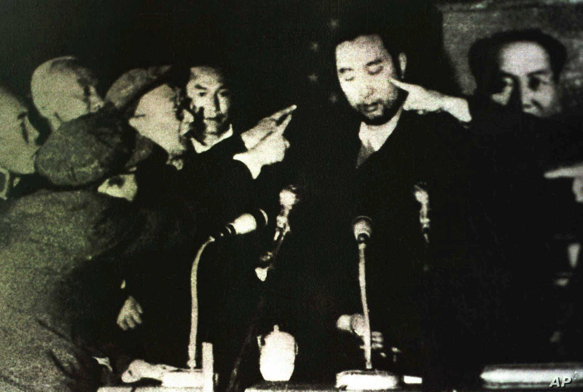 Tibet's 10th Panchen Lama is seen undergoing a Cultural Revolution struggle session in Tibet's capital Lhasa, in this 1964 photo.