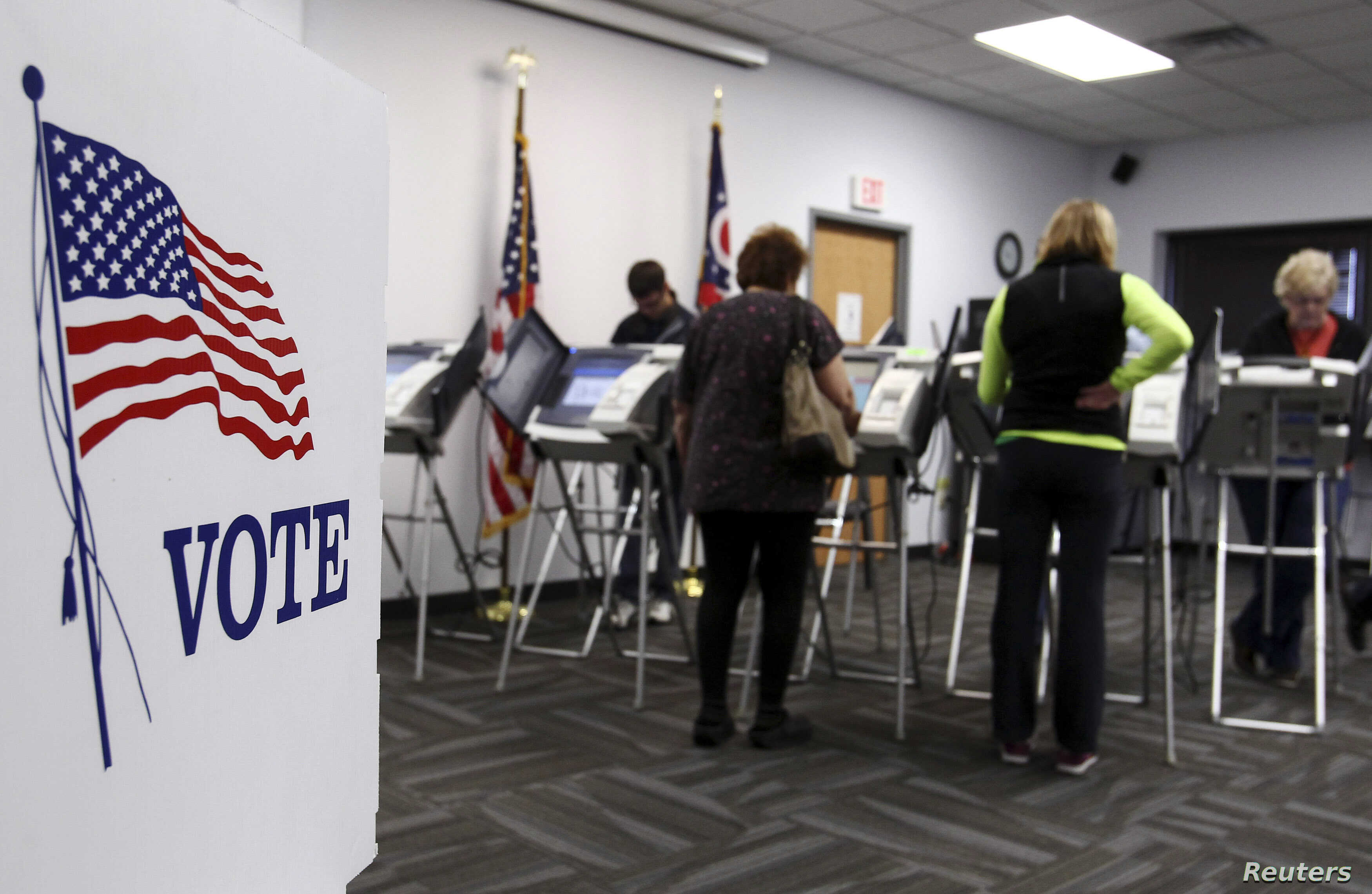 FILE - Ohio voters cast their votes at the polls for early voting in the 2012 U.S. presidential election in Medina, Ohio.