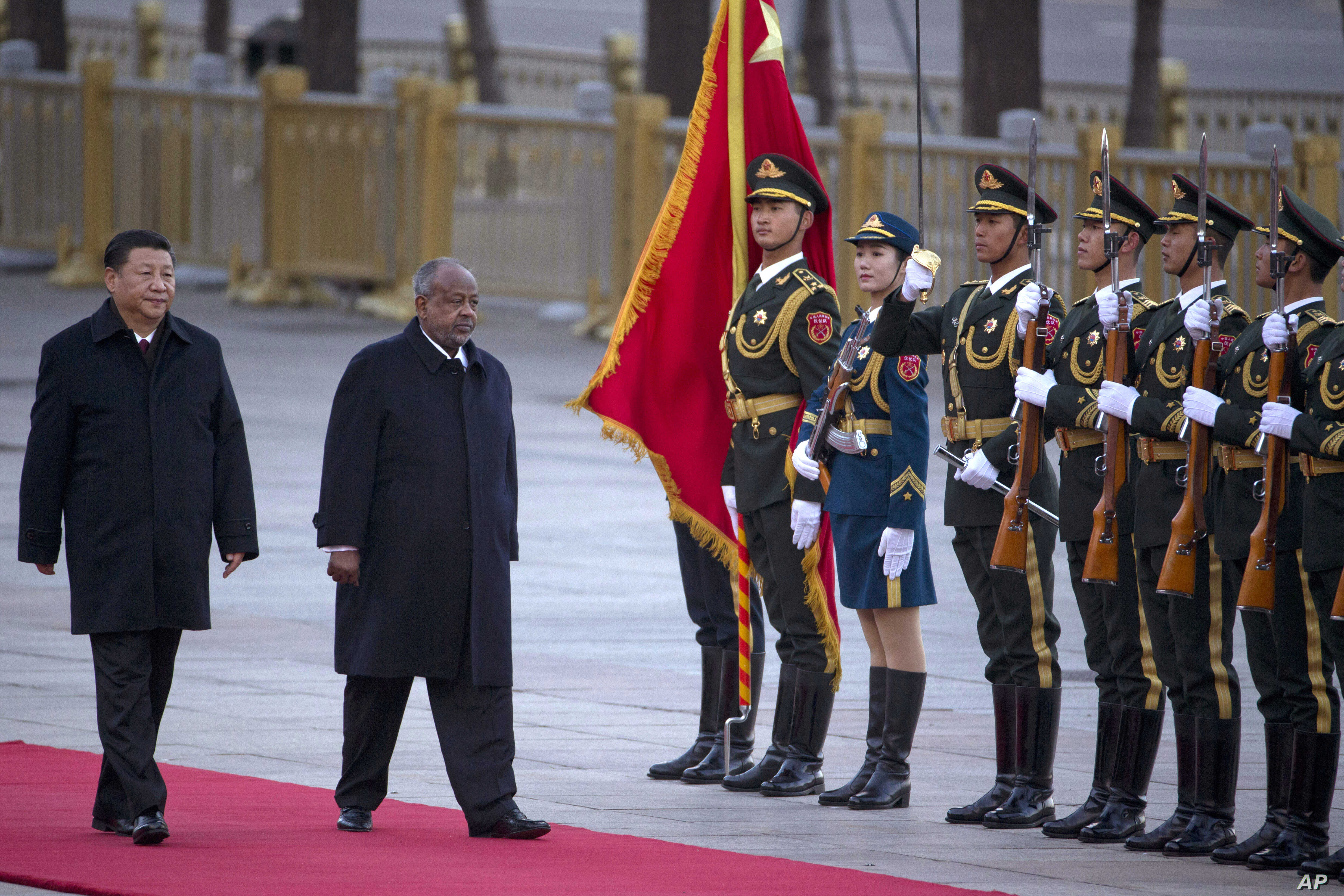 FILE - Djibouti's President Ismail Omar Guelleh (2nd-L) walks with Chinese President Xi Jinping during a welcome ceremony held outside the Great Hall of the People in Beijing, China, Nov. 23, 2017.