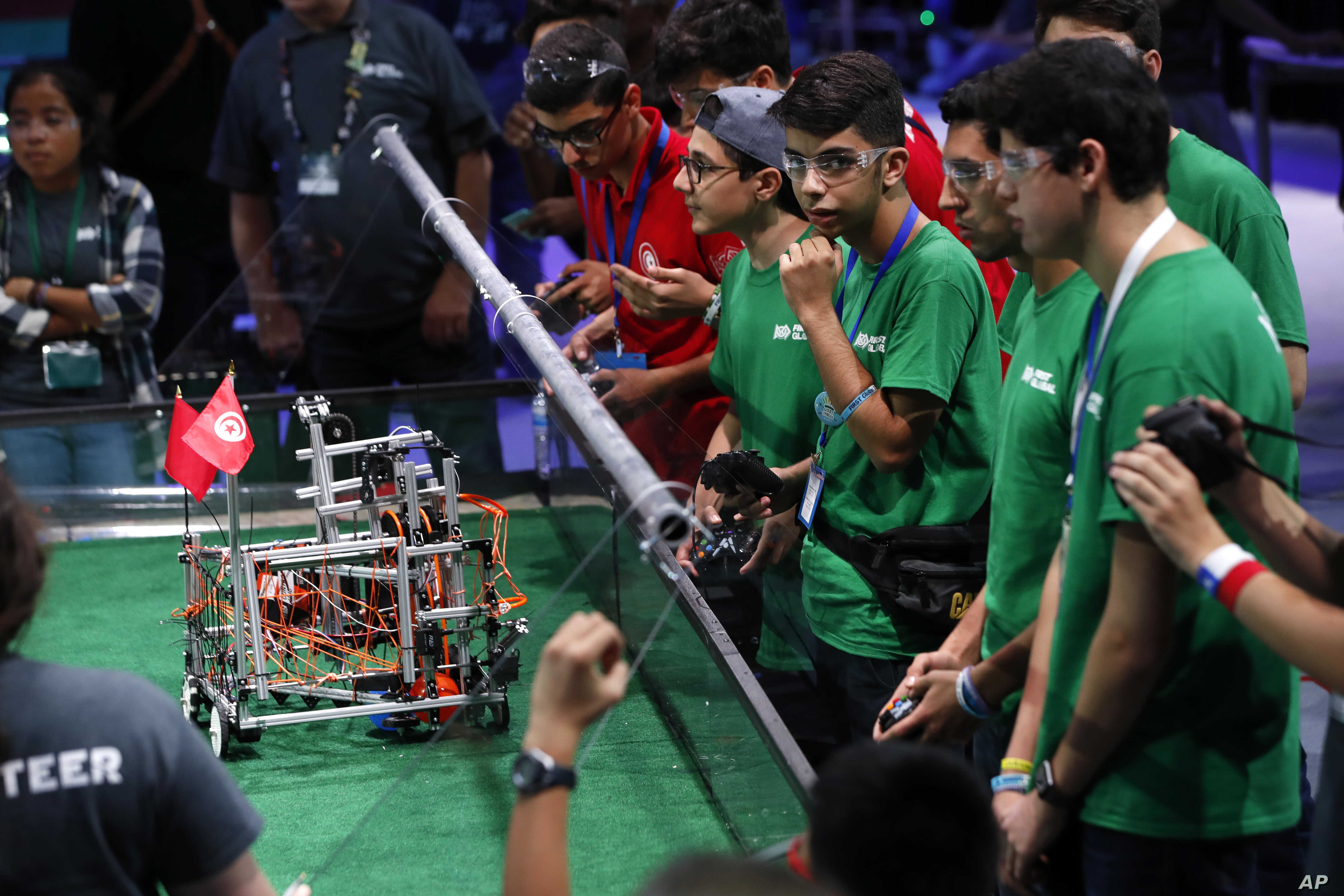 Team Iran, in green, competes in the FIRST Global Robotics Challenge, July 18, 2017, in Washington.