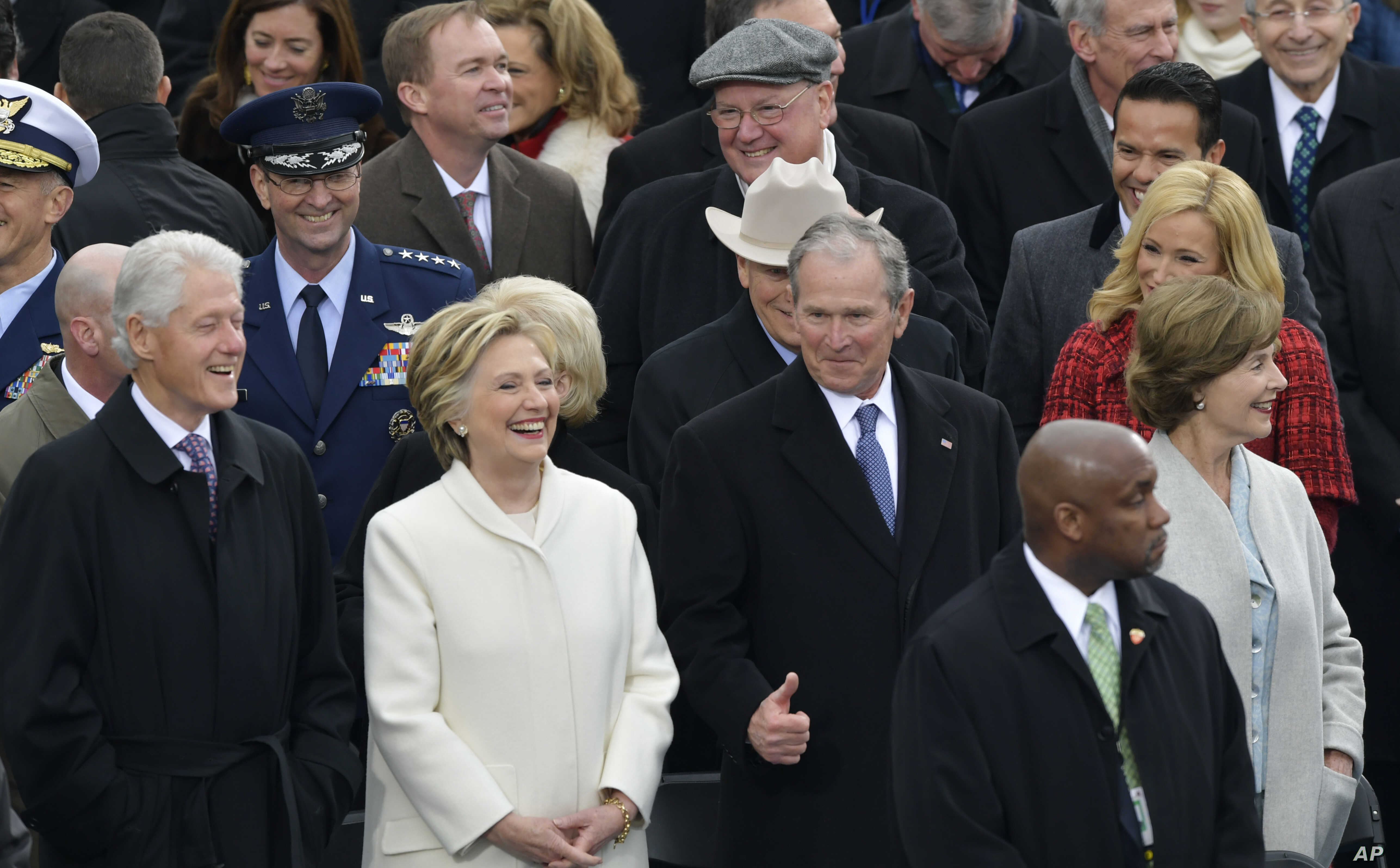 Former President George W. Bush, right, his wife Laura, Former Secretary of State Hillary Clinton and Former President Bill Clinton wait for the 58th Presidential Inauguration for President-elect Donald Trump at the U.S. Capitol in Washington, Jan. 2...