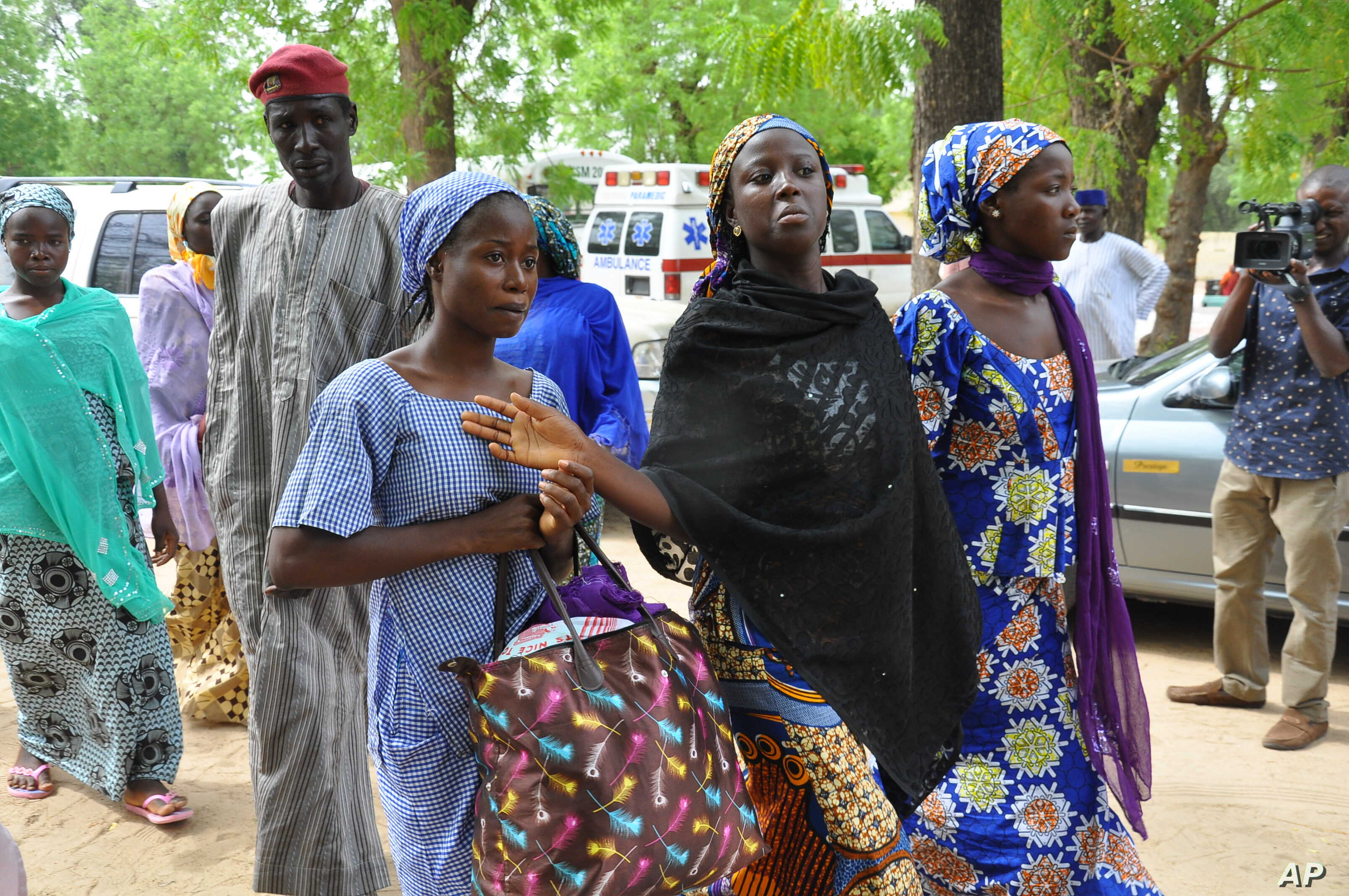 Boko Haram rebels are suspected of abducting dozens of men and boys in Nigeria. Chibok village schoolgirls who escaped the rebels are shown before meeting with Borno state's governor in Maiduguri June 2, 2014.