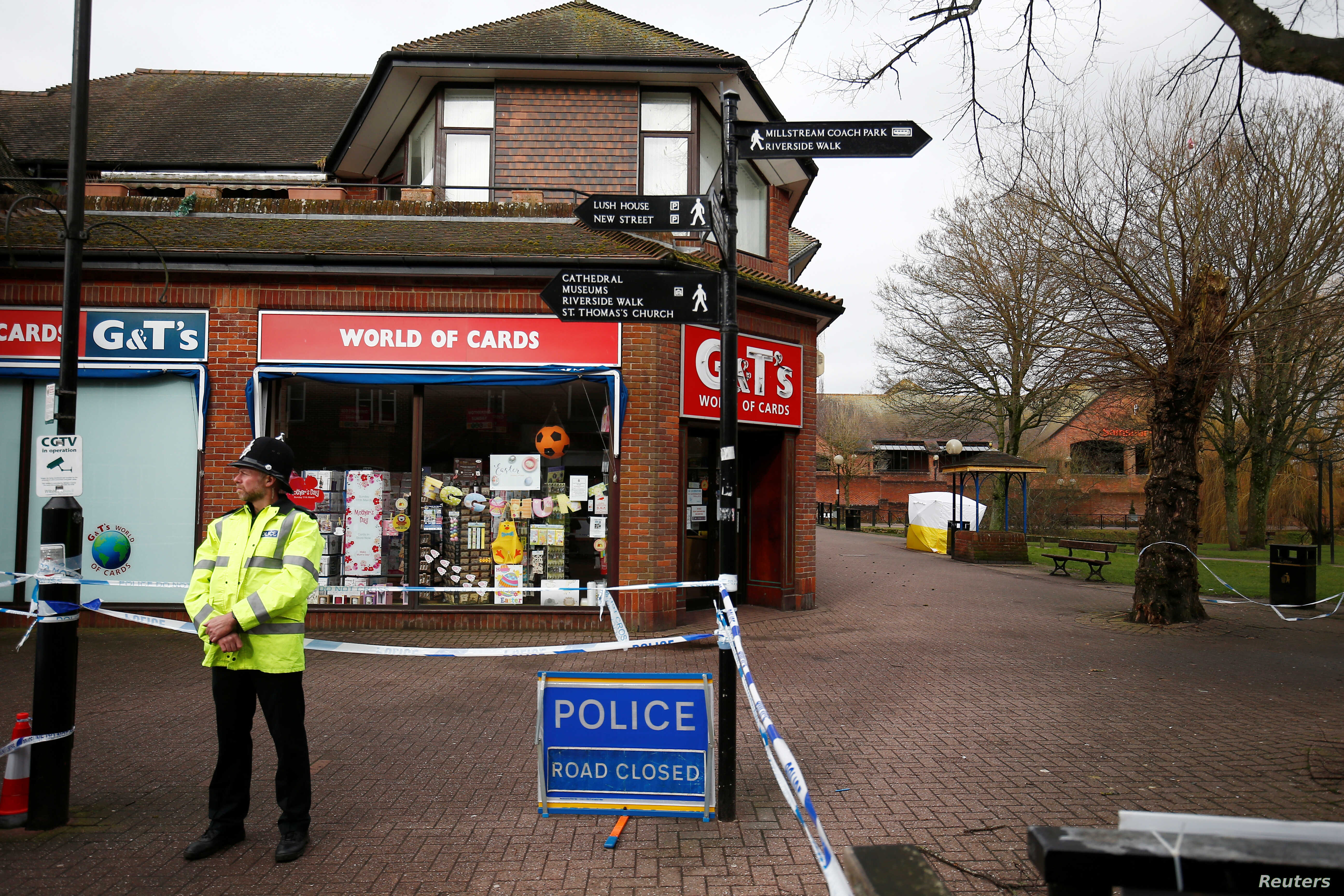 A police officer stands at a cordon around the bench where former Russian intelligence agent Sergei Skripal and his daughter Yulia were found after they were poisoned, in Salisbury, Britain, March 11, 2018.