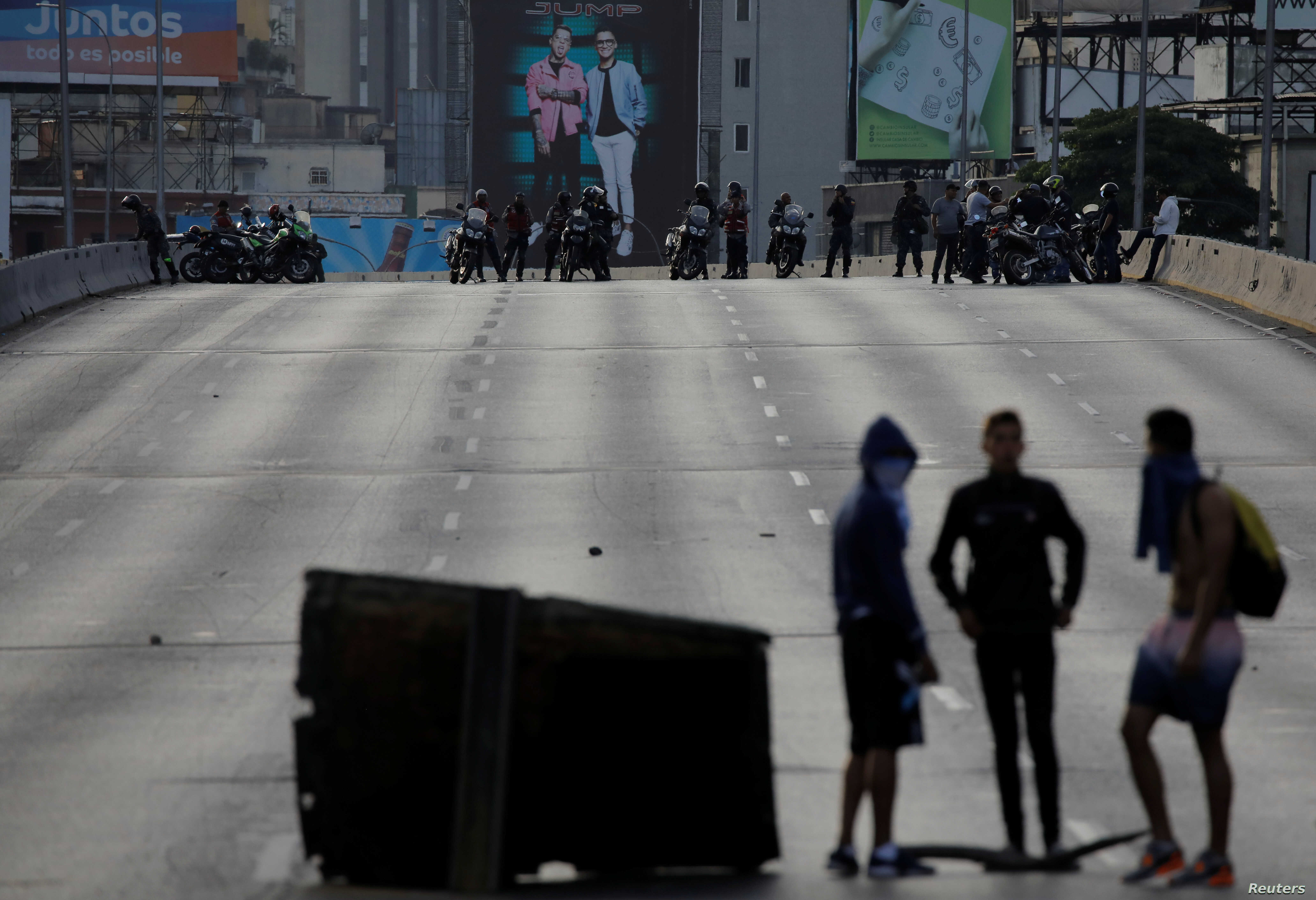 Demonstrators are seen with the security forces behind them during a protest against Venezuelan President Nicolas Maduro's government in Caracas, Venezuela, Feb. 2, 2019.