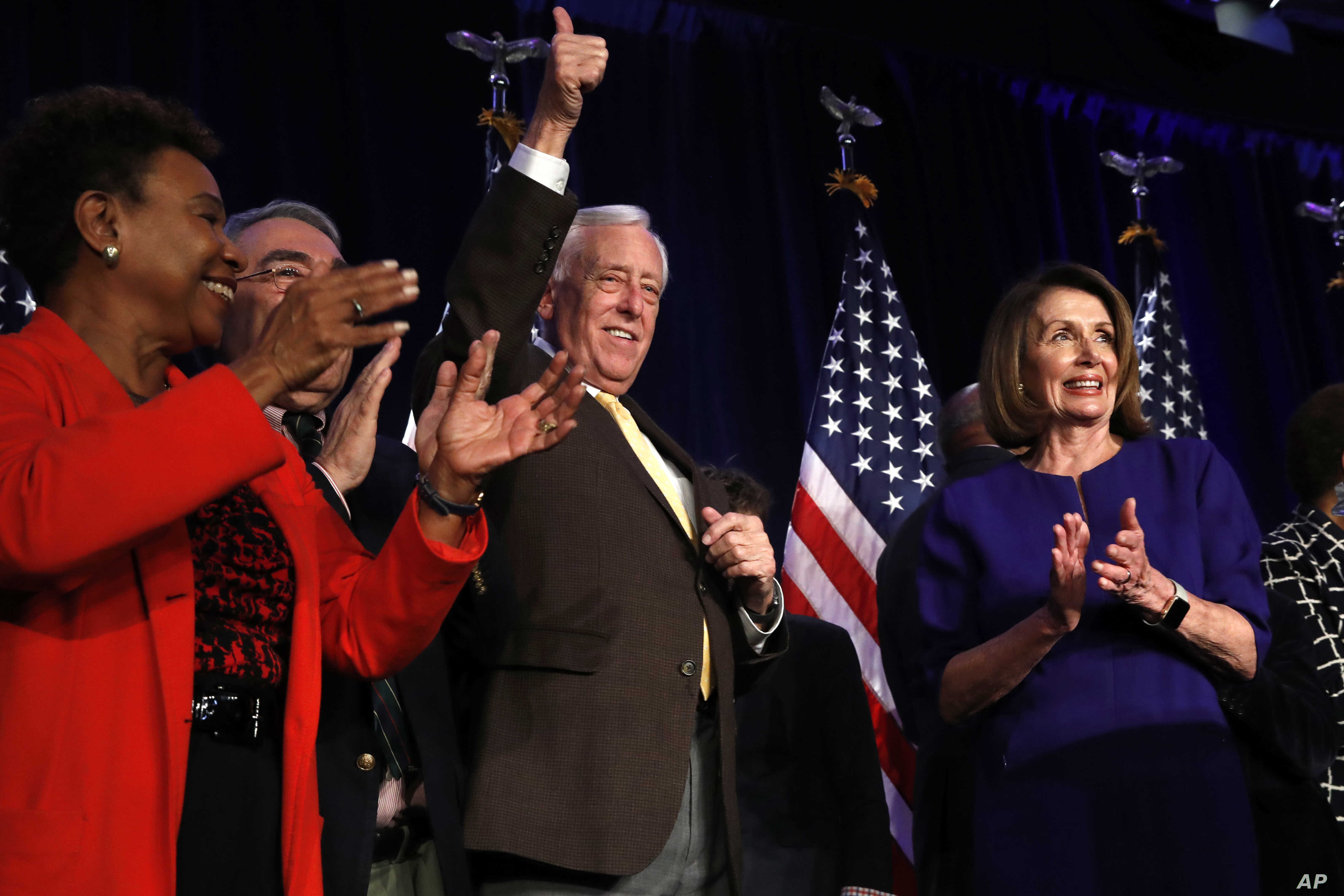 House Minority Leader Nancy Pelosi of Calif., right, steps away from the podium as House Minority Whip Steny Hoyer, D-Md., makes the thumbs up sign, after Pelosi spoke about Democratic gains in the House of Representatives to a crowd of Democratic su...