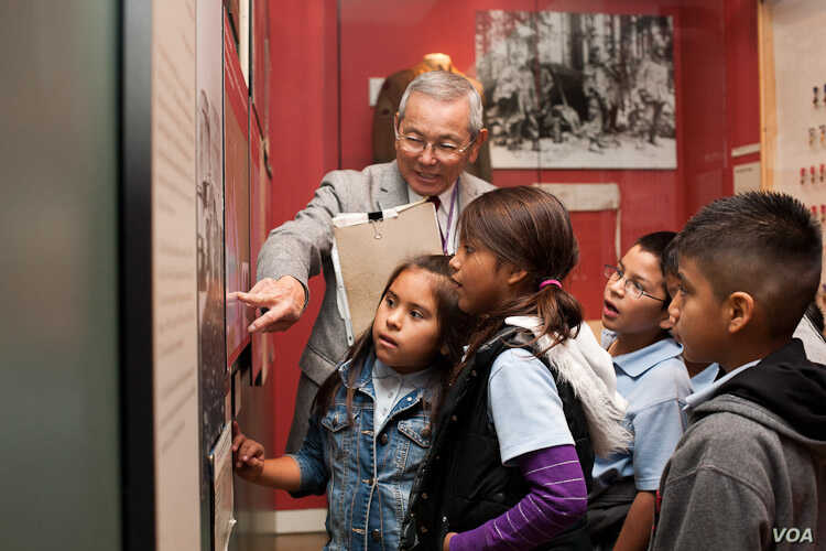 Mas Yamashita leads a school tour at the Japanese American National Museum where he volunteers every Friday. Yamashita, an American born in California, is one of the 120,000 people held in an internment camp during the WWII. (Courtesy: Japanese Ameri...