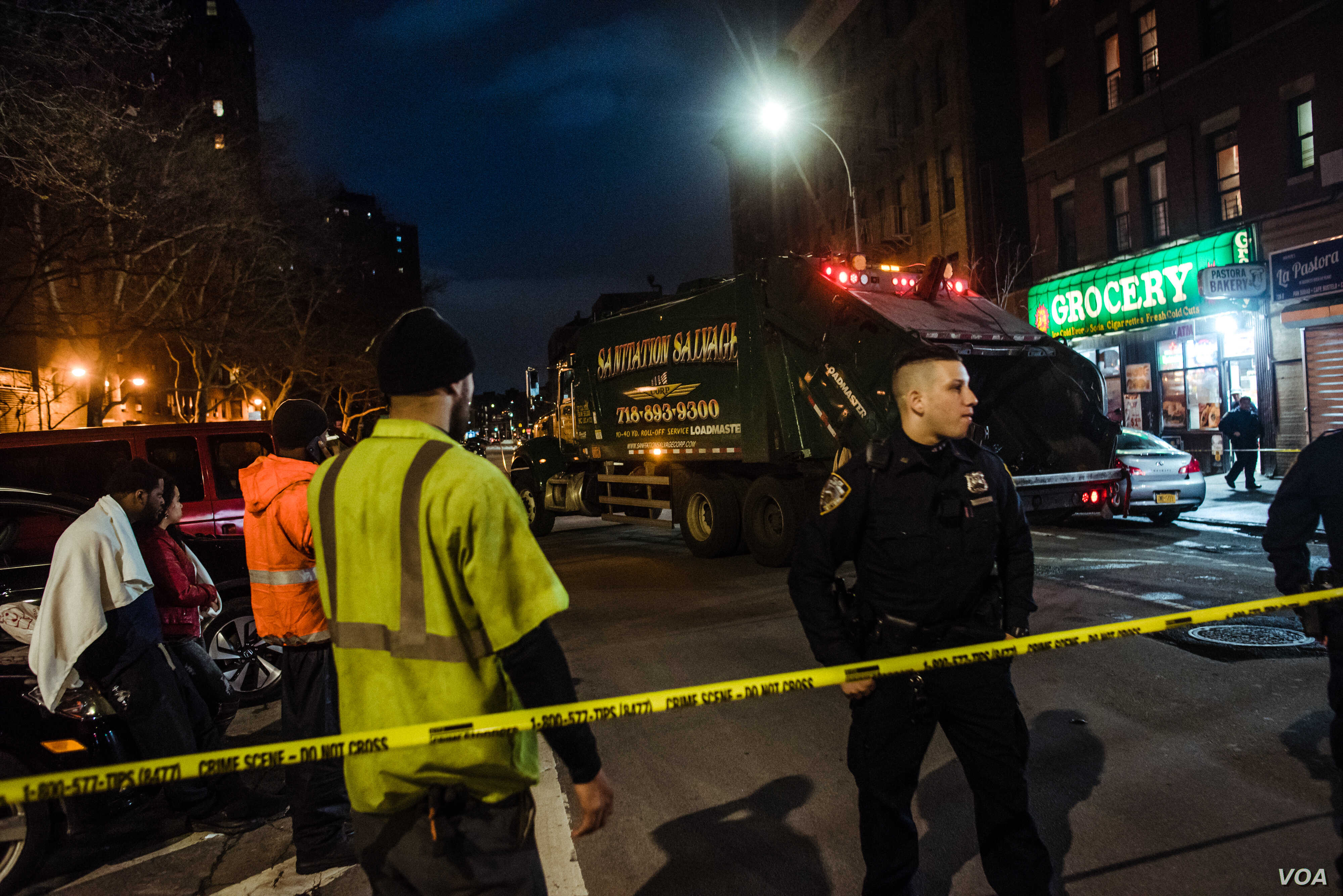 A Sanitation Salvage truck behind police tape at 152nd Street and Jackson Ave. in Woodstock, Bronx, April 27, 2018.