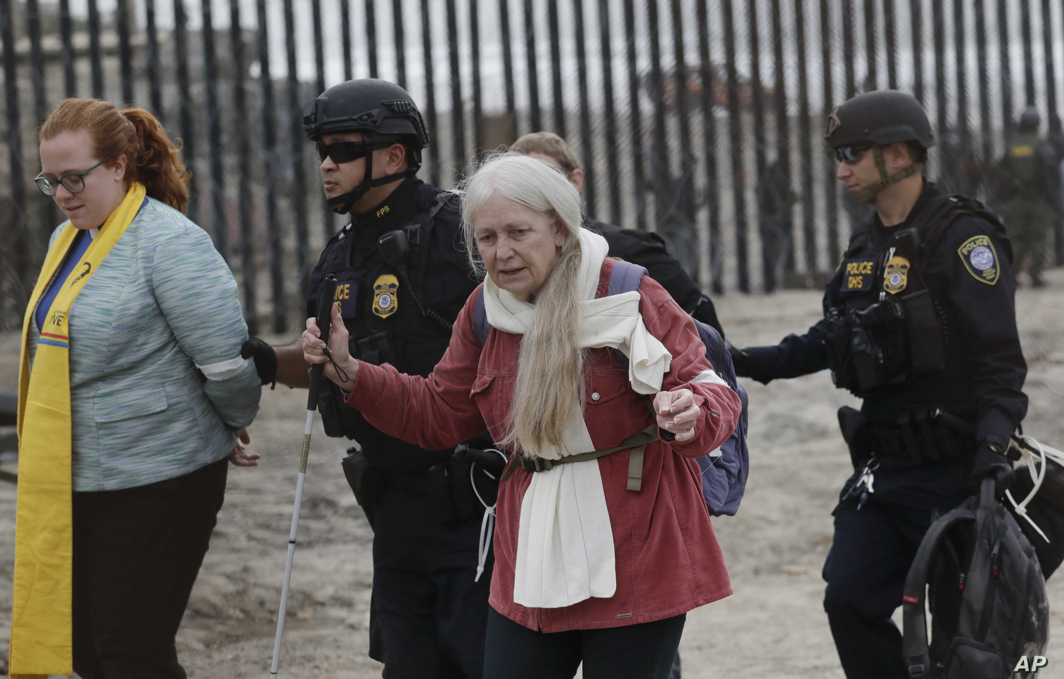 Women are detained during a protest in San Diego, near the border with Tijuana, Mexico, Dec. 10, 2018.