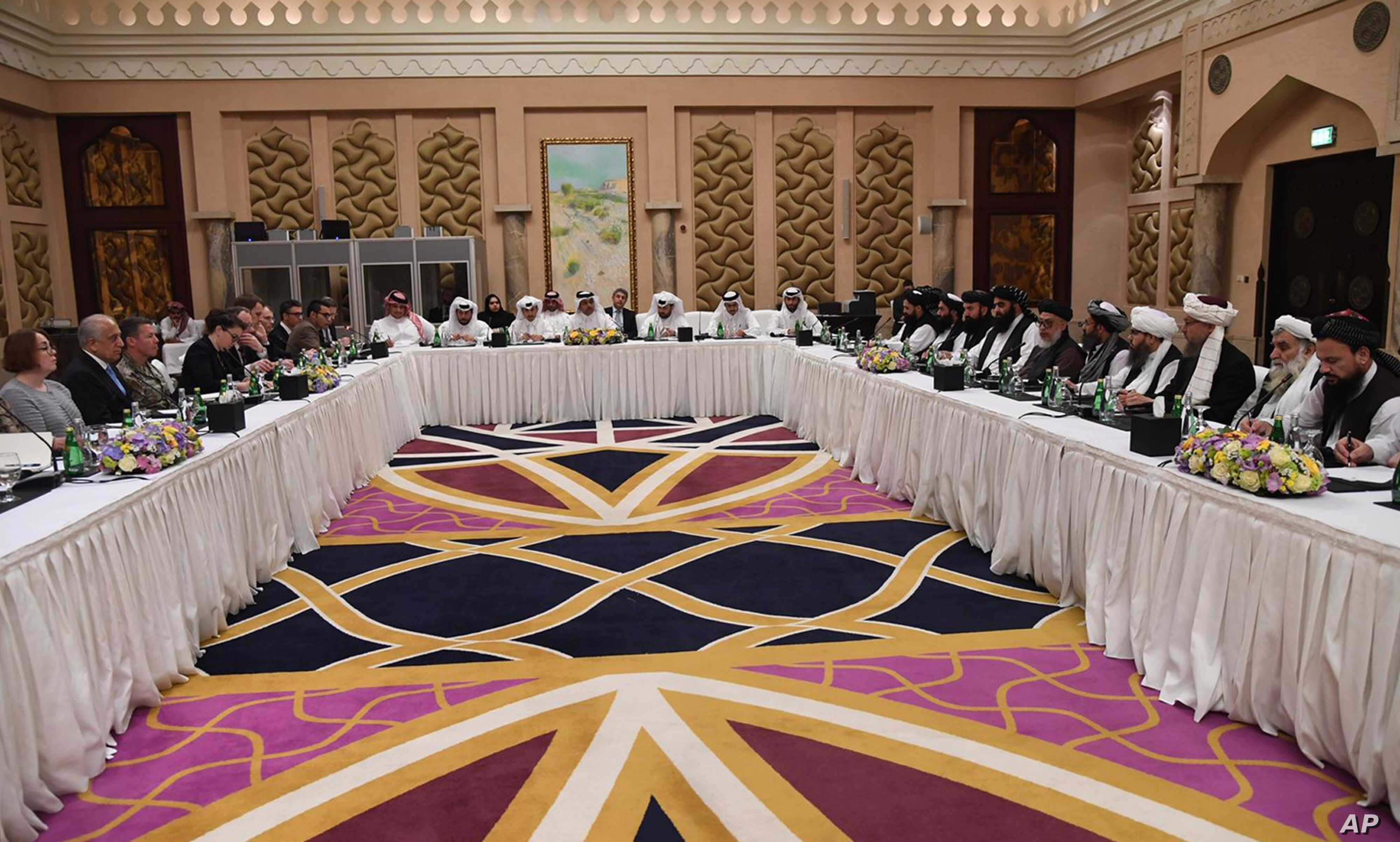 This photo released by Qatar's Ministry of Foreign Affairs shows Qatari, U.S. and Taliban officials conferring in an undisclosed place in Doha, Feb. 25, 2019, ahead of the latest round of talks with the insurgents aimed at ending the Afghan war.
