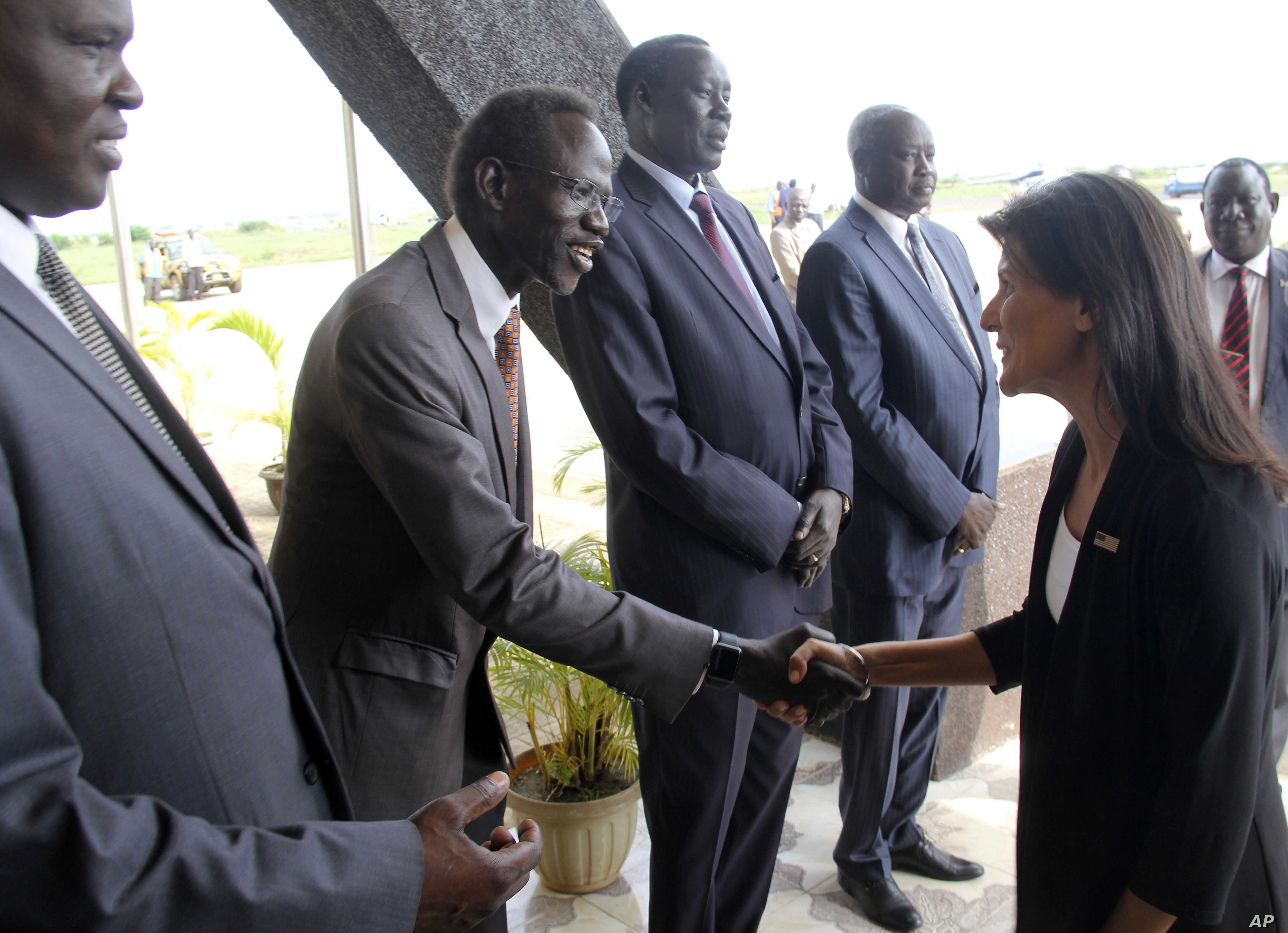 U.S. Ambassador to the United Nations Nikki Haley, right, meets South Sudanese officials on her arrival in Juba, South Sudan, Oct. 25, 2017.