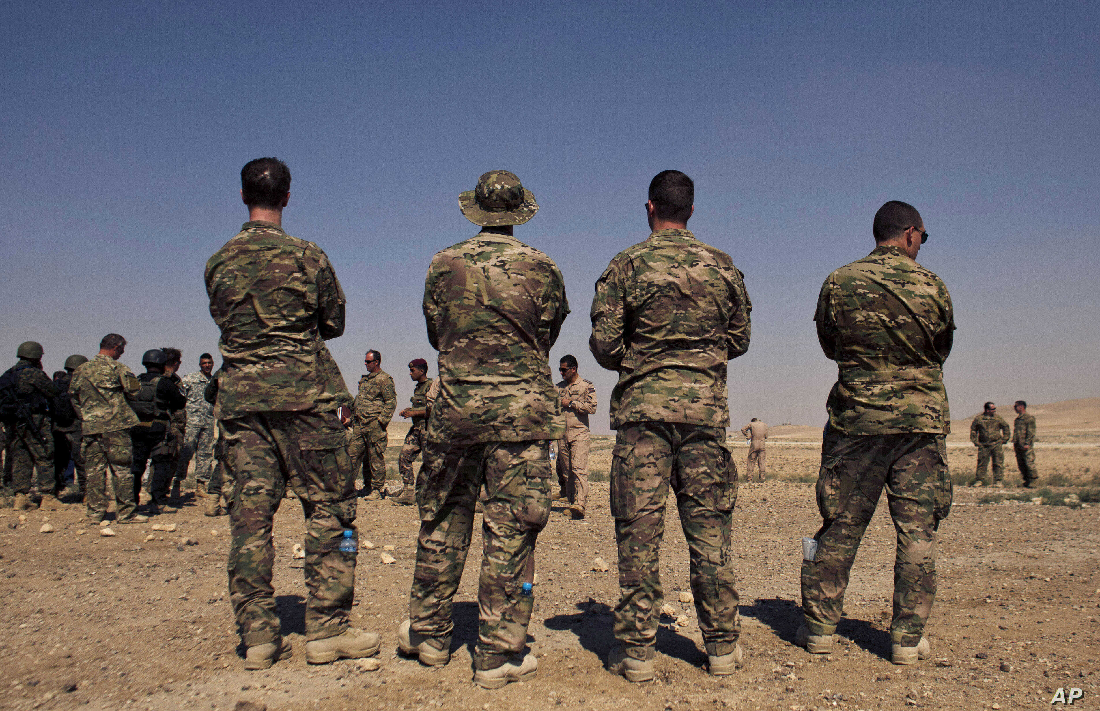 FILE - In this 2013 photo, US special operations forces watch forces from Iraq, Jordan, and Lebanon during a multinational military exercise in Zarqa, Jordan. The government-owned Al-Rai newspaper said Monday a Jordanian policeman opened fire on Amer...