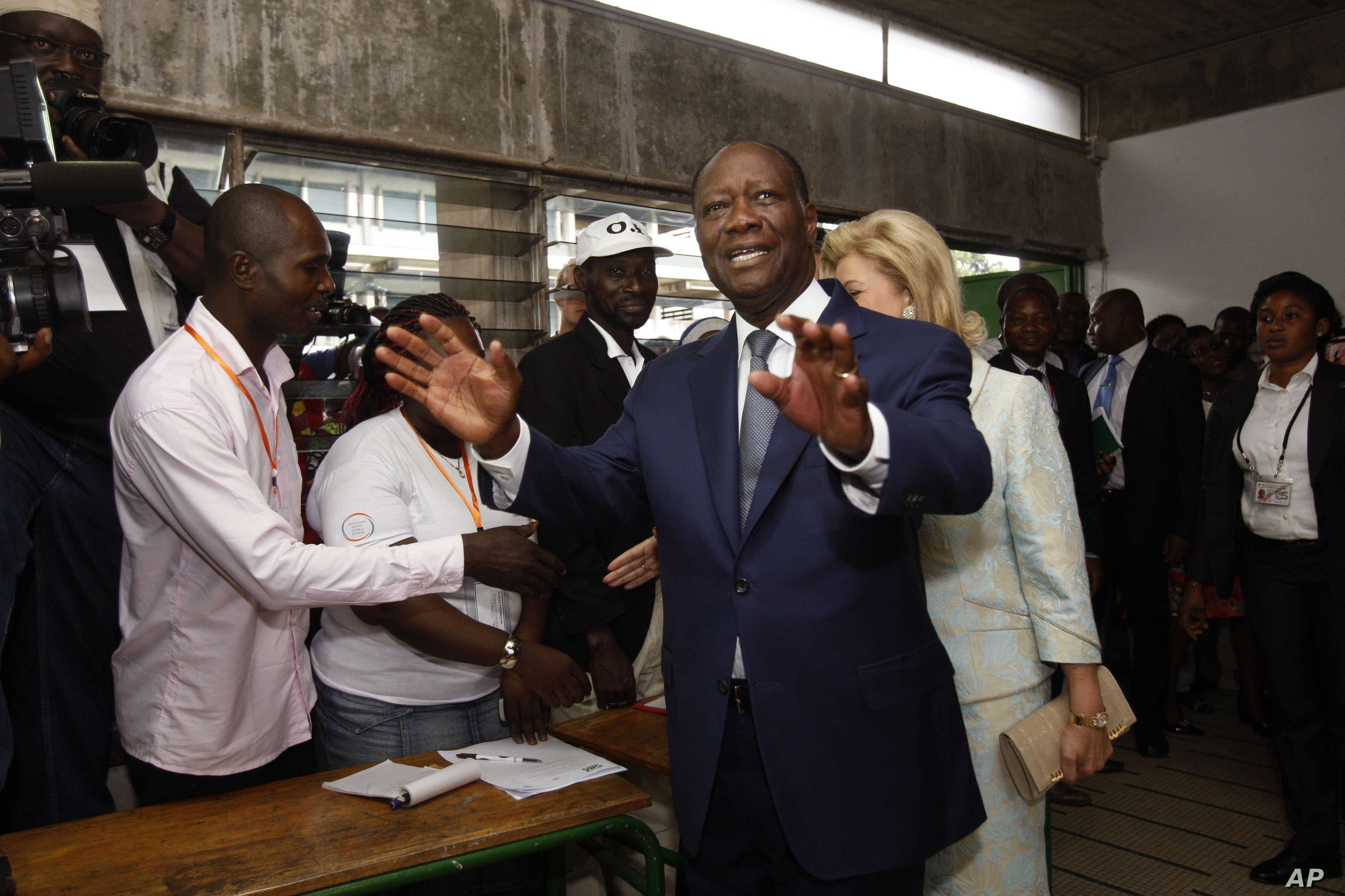 Ivory Coast's president Alassane Ouattara arrives inside a polling station to cast his ballot during elections in Abidjan, Ivory Coast, Oct. 25, 2015.