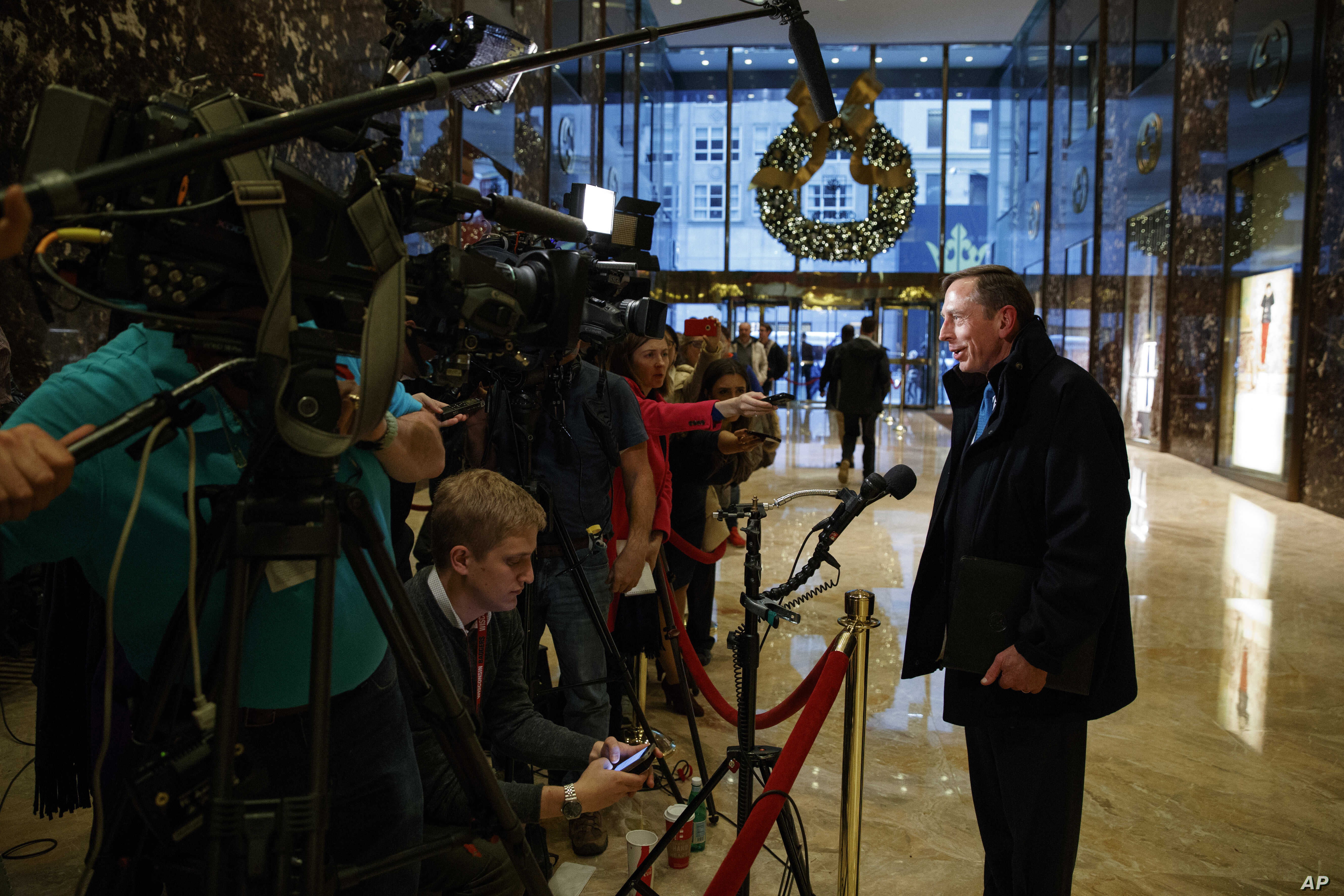 Former CIA director and retired Gen. David Petraeus talks with reporters after a meeting with President-elect Donald Trump, Monday, Nov. 28, 2016, in New York. Petraeus is being considered for cabinet position of secretary of state.
