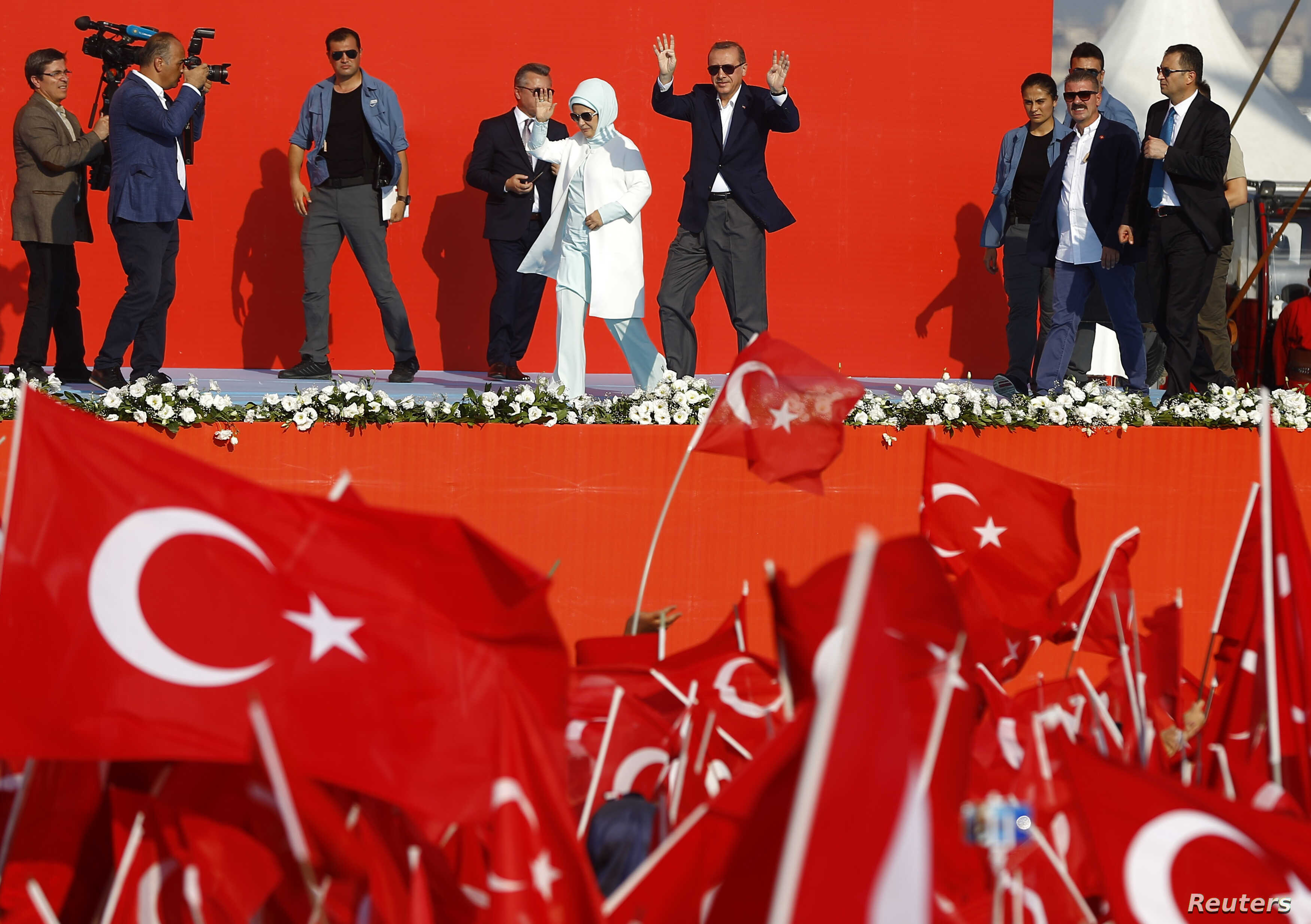 Turkish President Tayyip Erdogan and his wife  Emine Gulbaran attend Democracy and Martyrs Rally, organized by him and supported by ruling AK Party (AKP), oppositions Republican People's Party (CHP) and Nationalist Movement Party (MHP), to protest ag...
