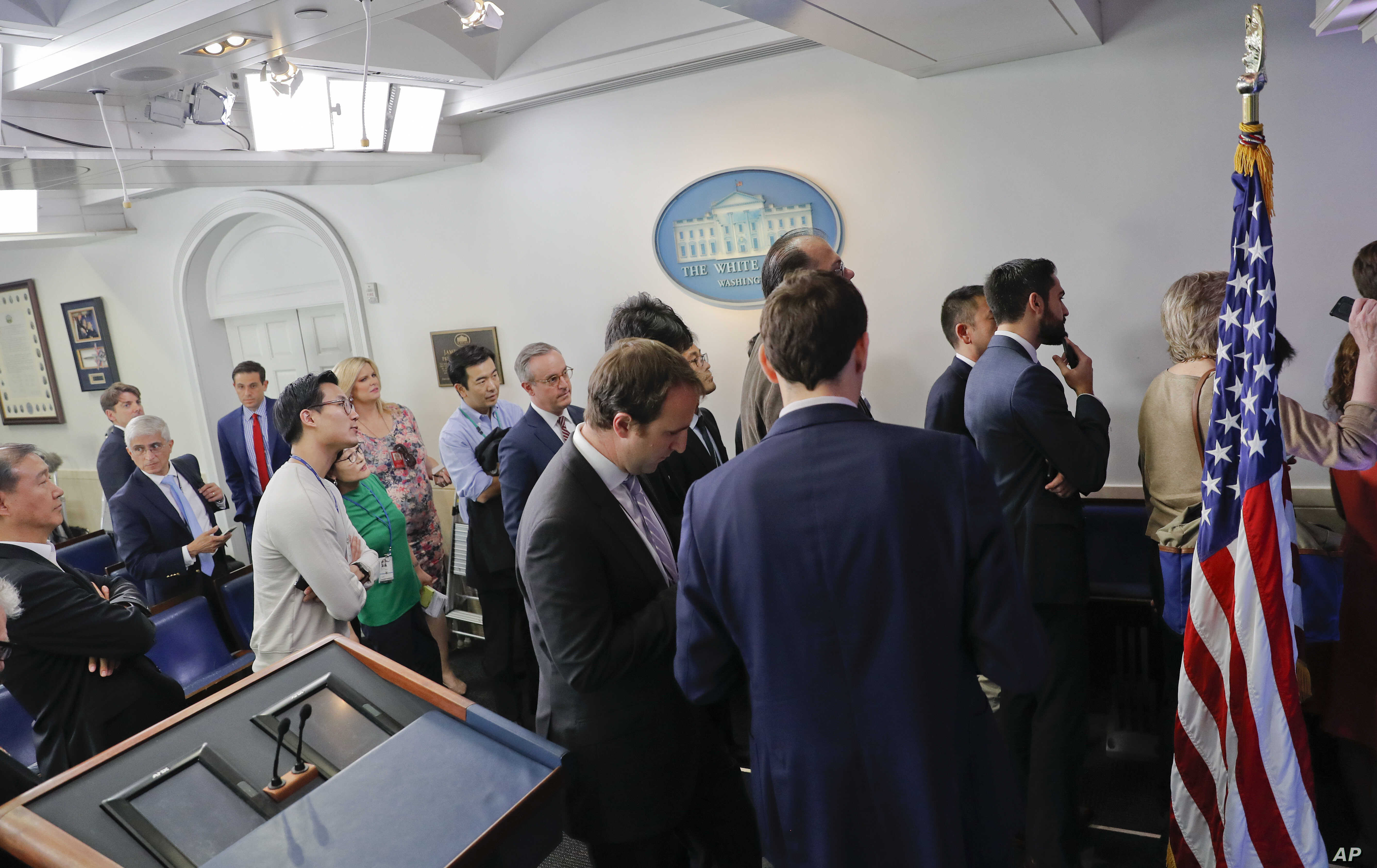Reporters line up in hopes of attending a briefing in Press Secretary Sean Spicer's office at the White House in Washington, Feb. 24, 2017. White House held an off camera briefing in Spicer's office, where they selected who could attend.