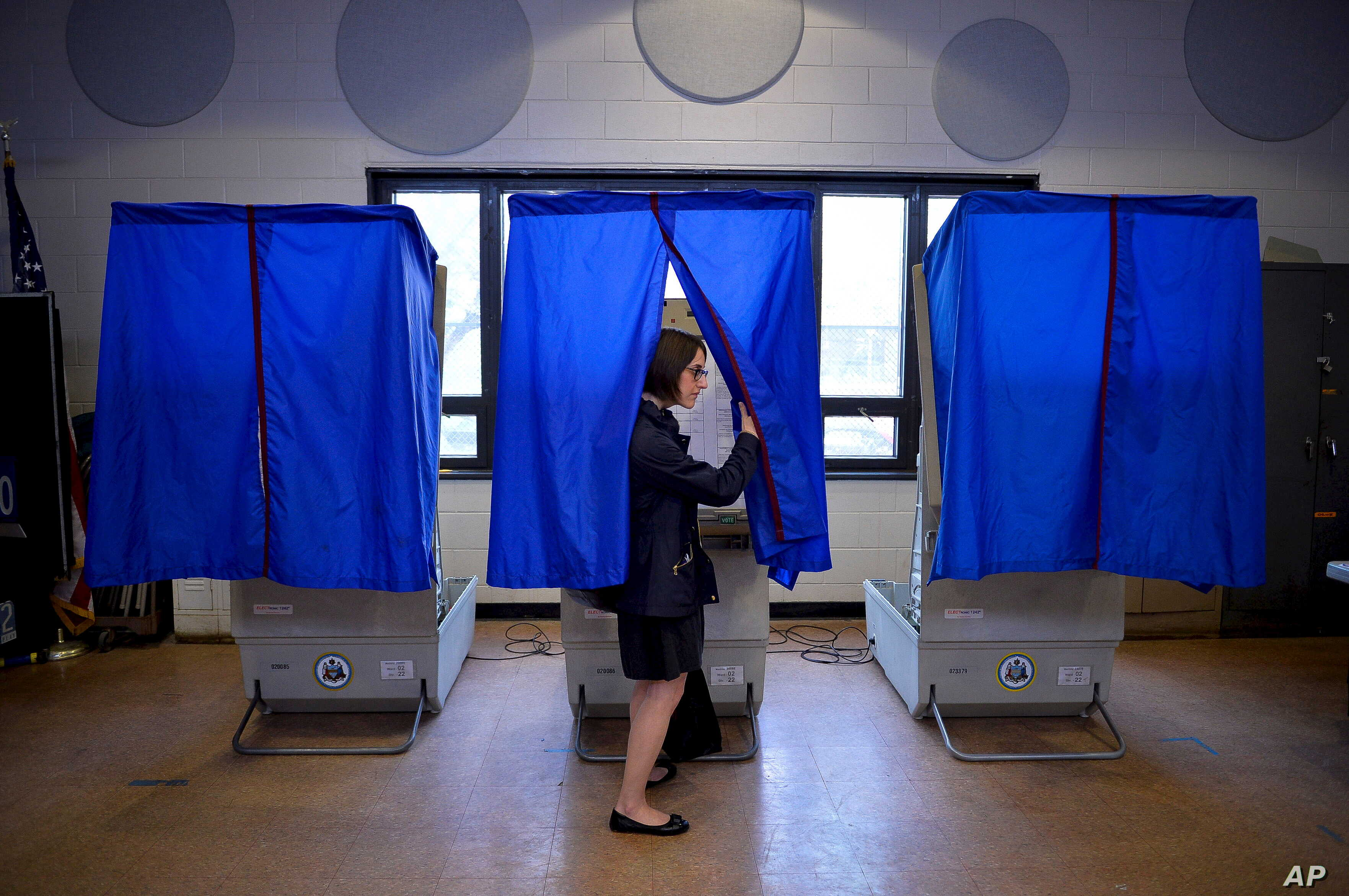 FILE - A voter leaves the booth after casting her ballot in the Pennsylvania primary at a polling place in Philadelphia, Pennsylvania, U.S., April 26, 2016.