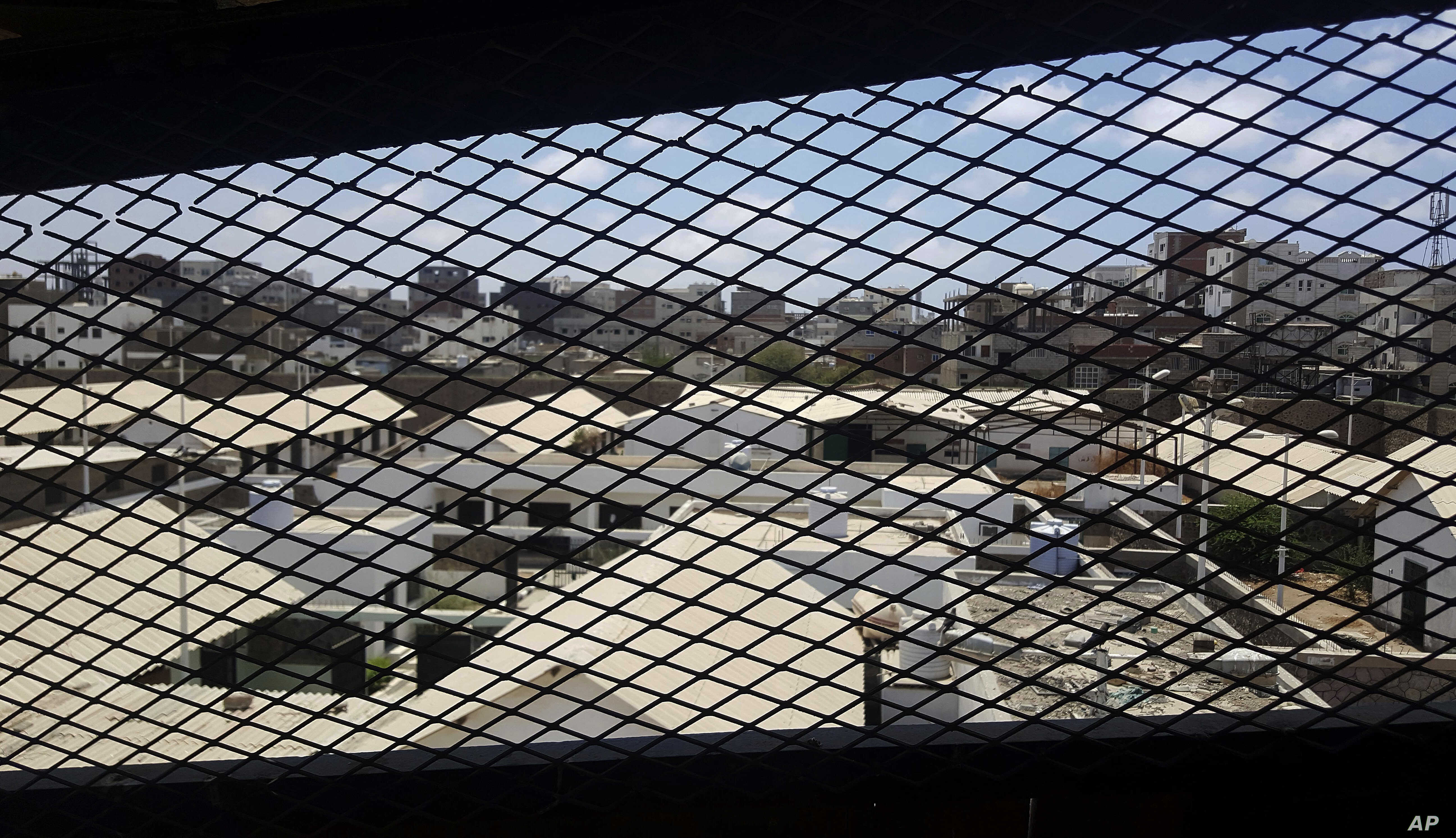 A view through a mesh window looks out over part of Aden Central Prison, known as Mansoura, in this May 9, 2017, photo in Aden, Yemen. A section of the prison is run by Yemeni allies of the United Arab Emirates, part of a network of secret prisons in