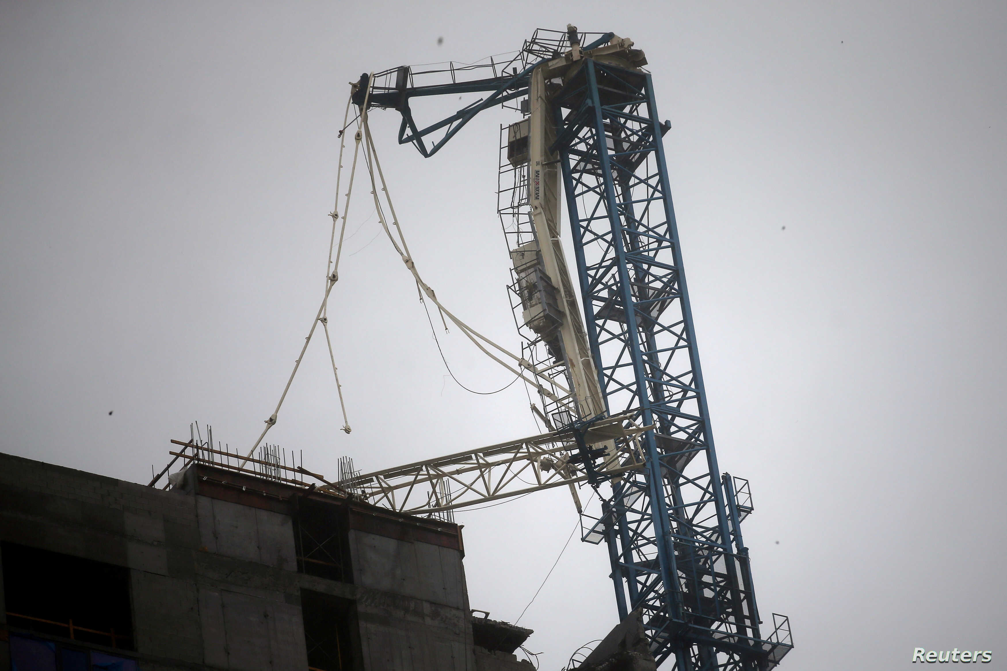 Collapse Of Florida Condo Boom >> 2 Huge Cranes Atop Miami High Rises Collapse In Irma S Winds Voice