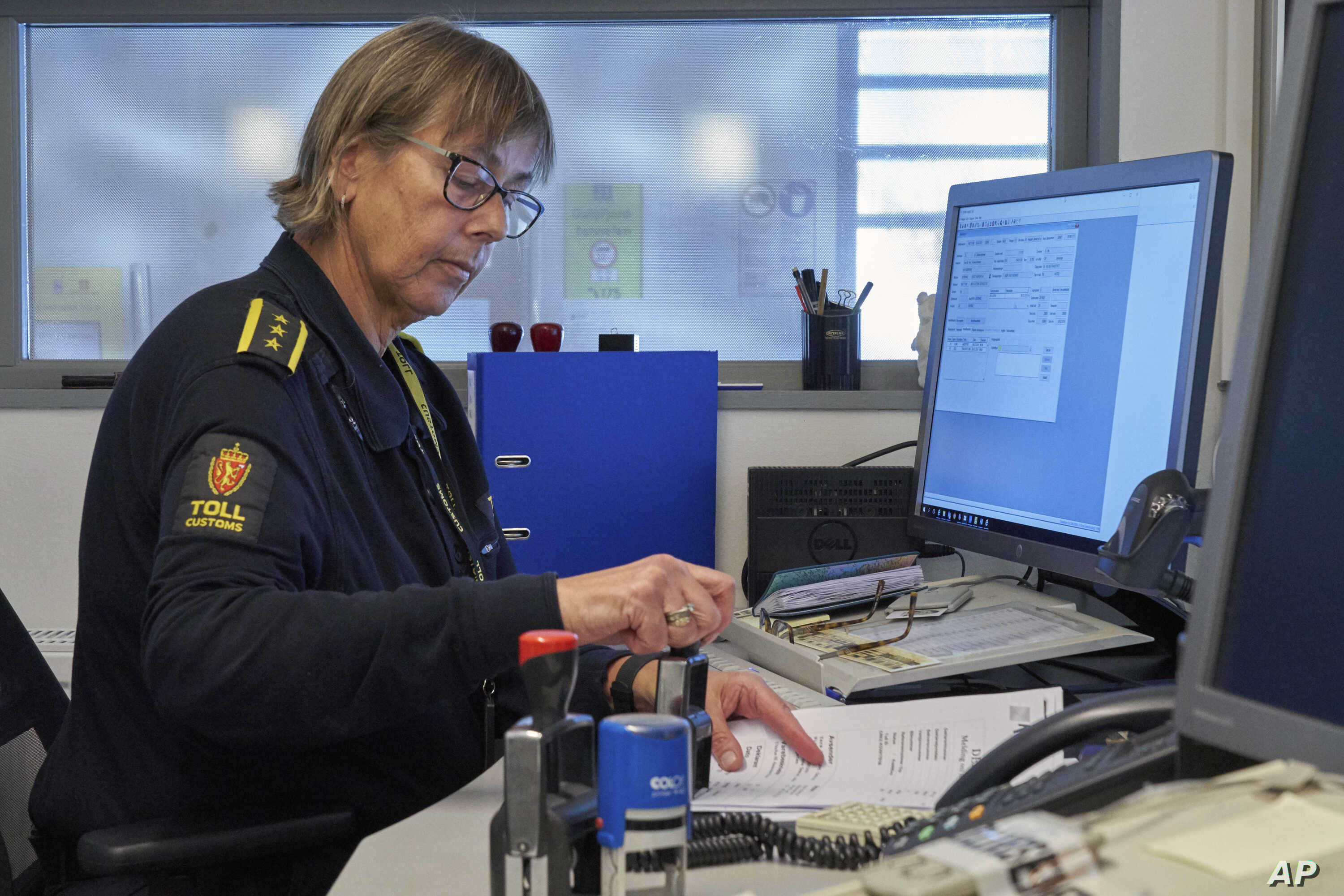 Chief Customs officer Nina Bullock was handling traditional paper clearance forms, Feb. 8 2019, as her computer informed her of an incoming truck using a new digital customs clearance system that allows transporters to drive through customs without s...