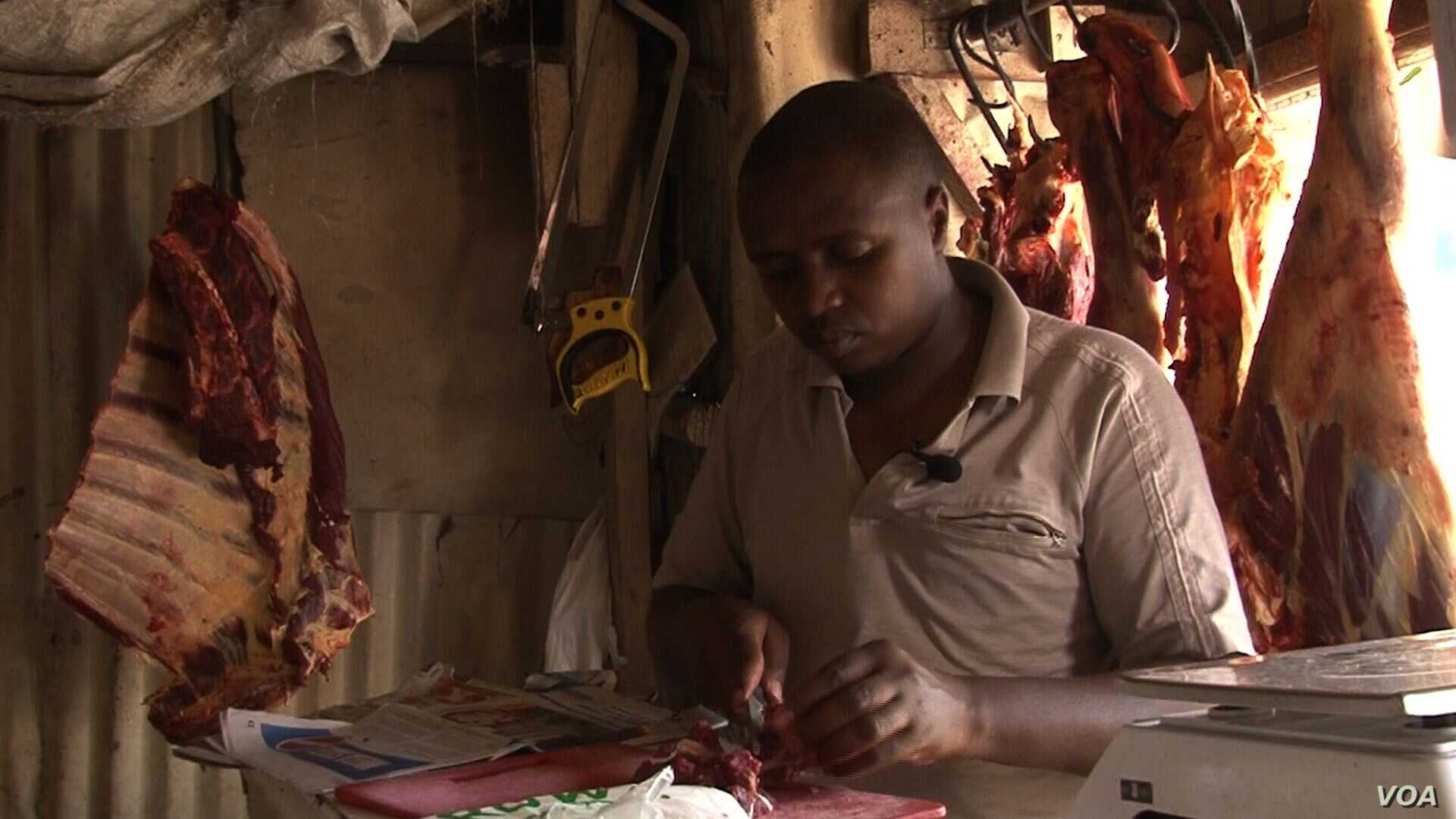 After learning how quickly meat spoils without refrigeration, butcher James Kuria buys less and keeps it for less time. (Credit: S. Baragona/VOA)