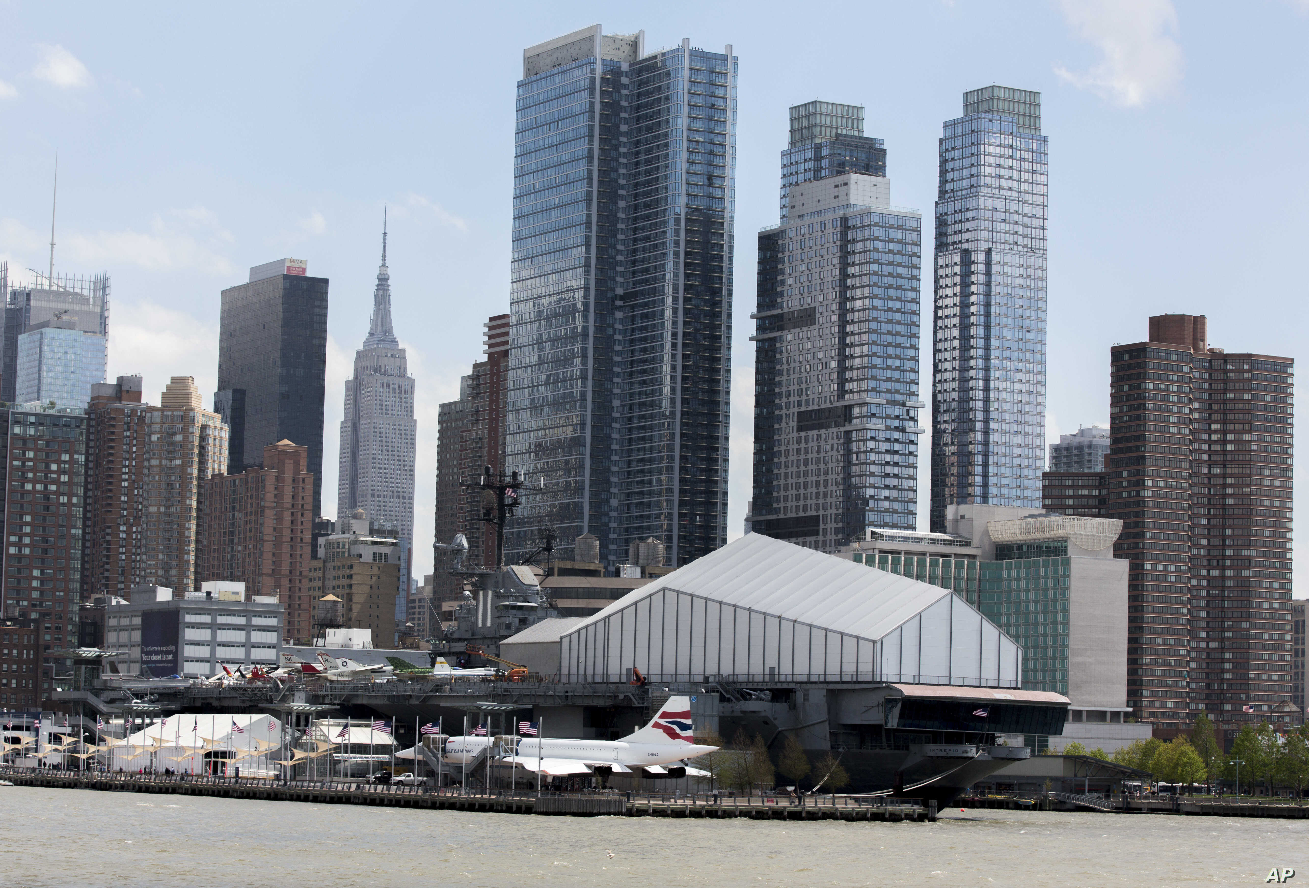 The Manhattan skyline with the Empire State Building rises behind the Intrepid Sea, Air & Space Museum in New York, May 2, 2017. Australian Prime Minister Malcolm Turnbull and President Donald Trump will attend the 75th Anniversary Battle of the Cor...
