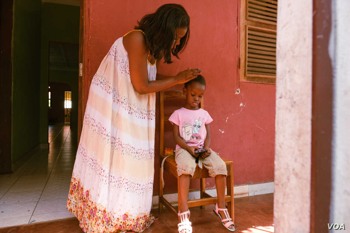 """Adele dos Santos, pictured here in Bissau, Guinea Bissau, Nov. 22, 2018, is a fashion designer, mother, and member of the """"Young Women Entrepreneurs"""" group in Bissau. She says societal pressures to take care of the household - and not spend too muc..."""