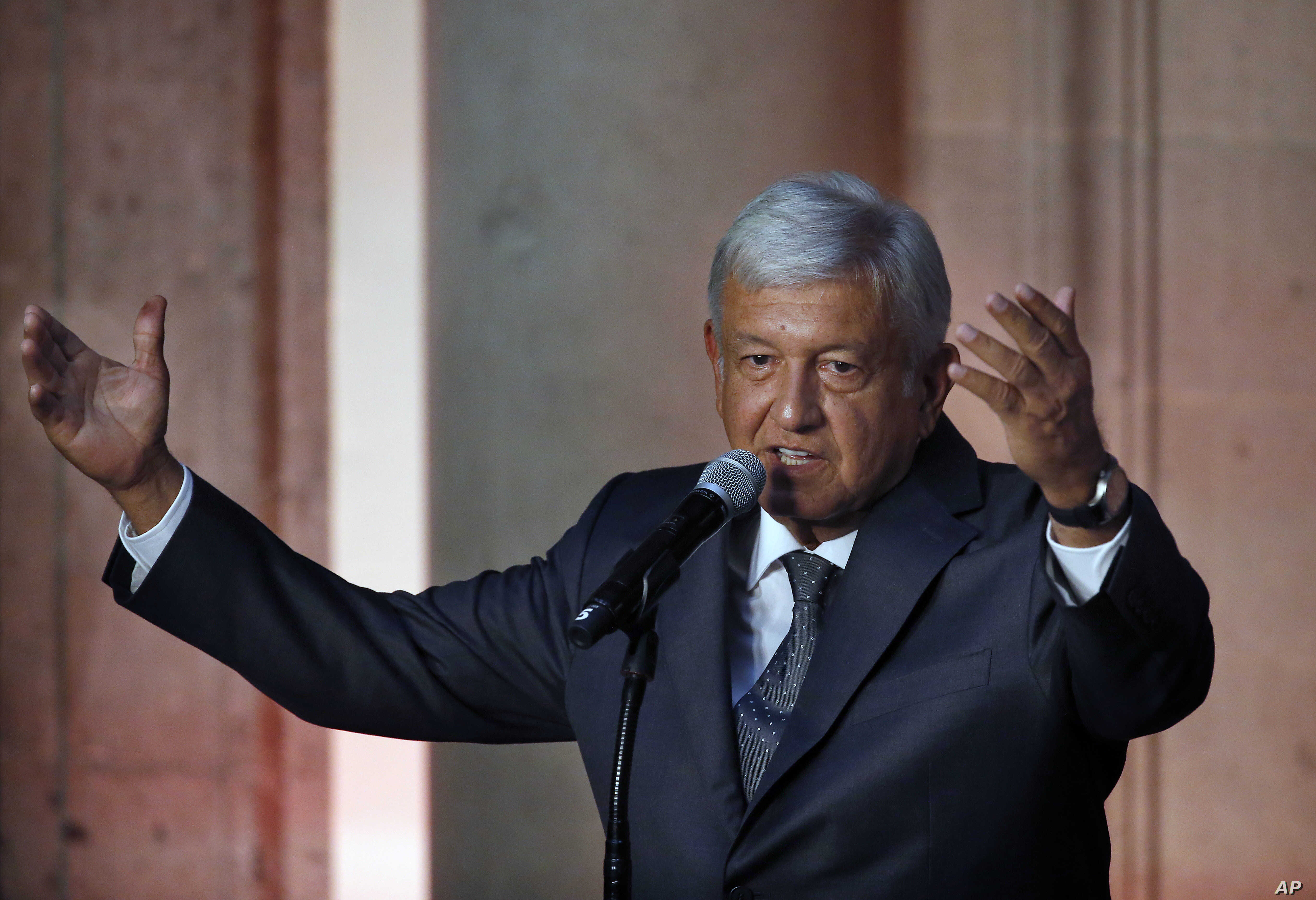 Mexico's President-elect Andres Manuel Lopez Obrador speaks to reporters after meeting with Mexico's President Enrique Pena Nieto at the National Palace in Mexico City, July 3, 2018.