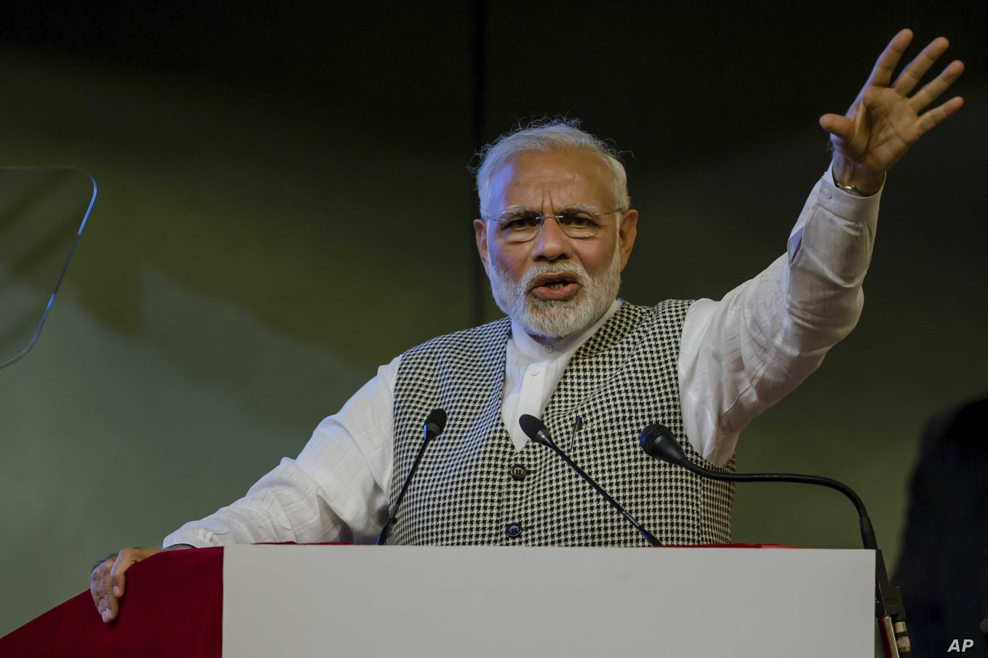 Indian Prime Minister Narendra Modi speaks during a function to inaugurate the Kishanganga hydropower station in Srinagar, Indian-controlled Kashmir, May 19, 2018.