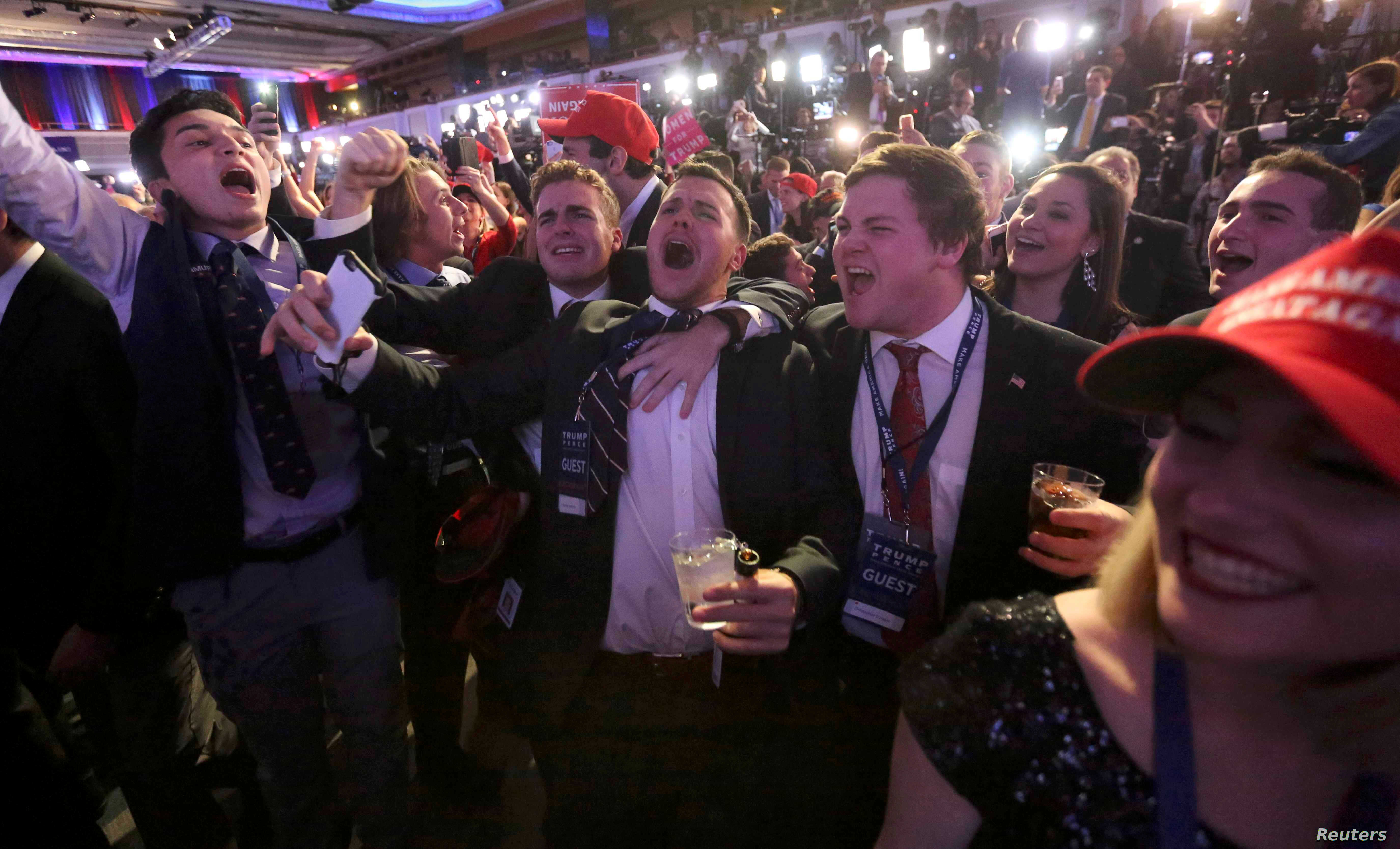Supporters of U.S. Republican presidential nominee Donald Trump react at his election night rally in Manhattan, New York, Nov. 8, 2016.
