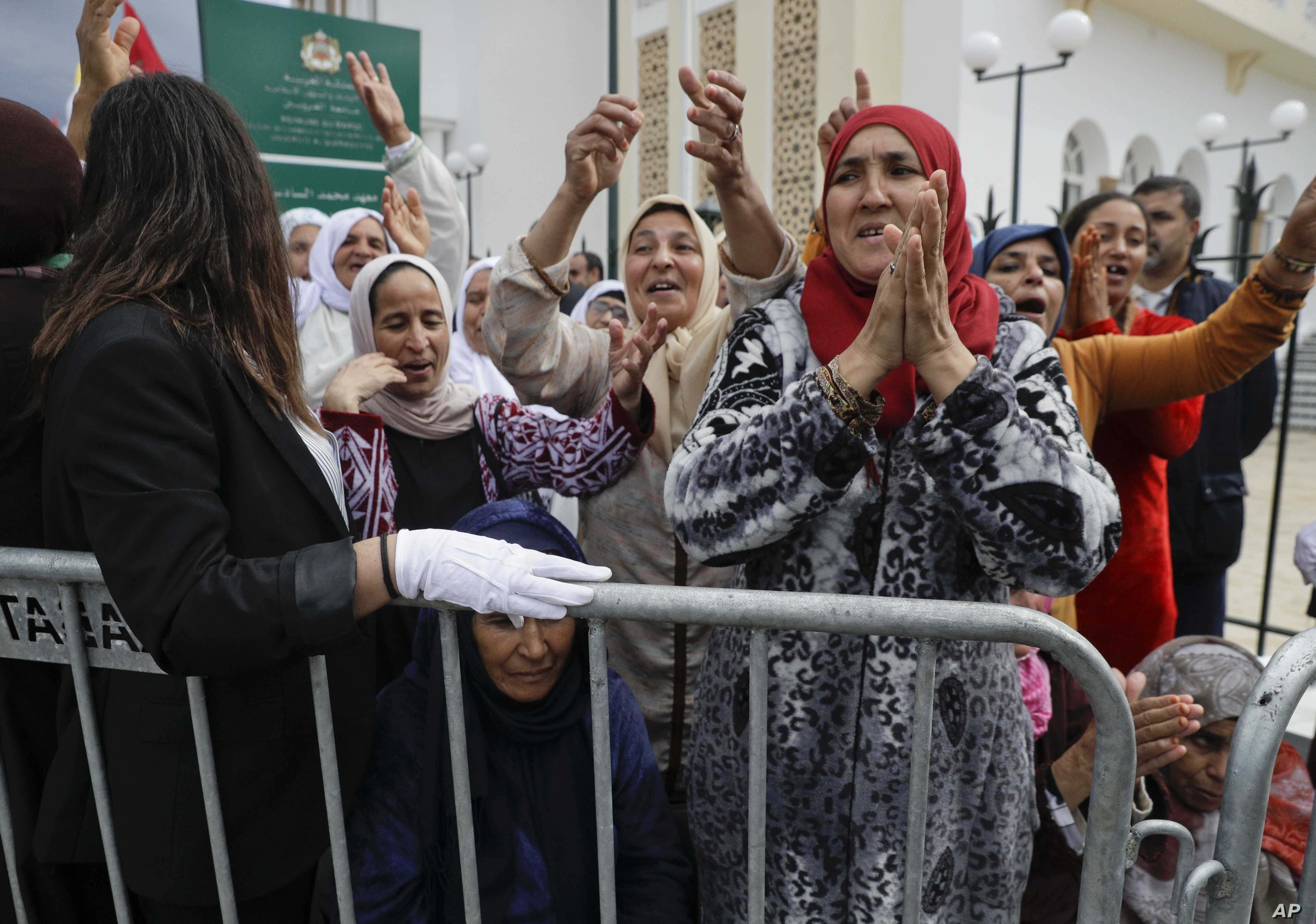 Women cheer as they wait for Pope Francis to arrive at the Mohammed VI Institute, a school of learning for imams, in Rabat, Morocco, March 30, 2019.