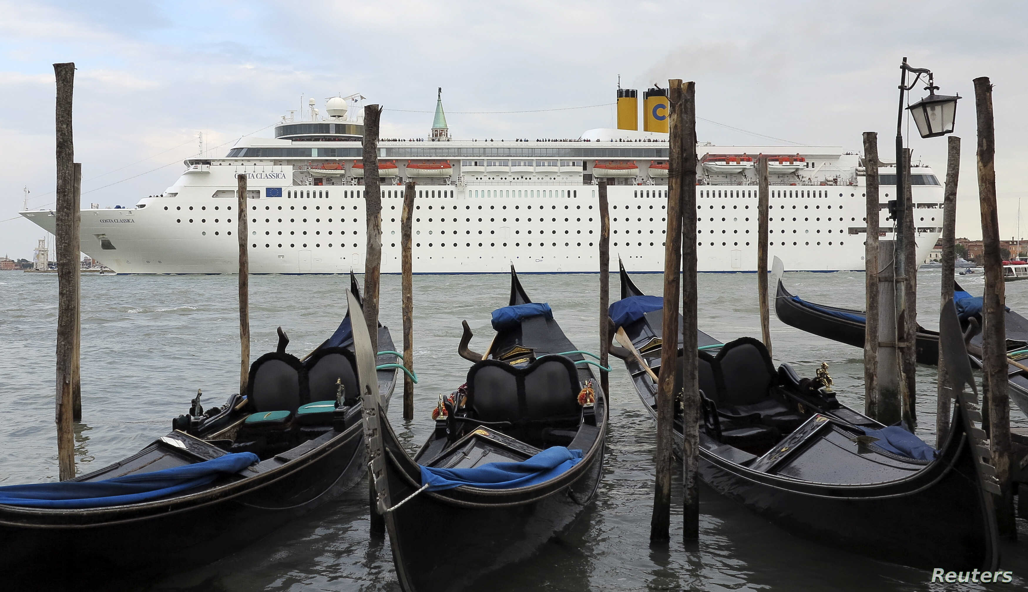 FILE - The Costa Classica cruise ship is seen in the Venice lagoon, May 18, 2012.