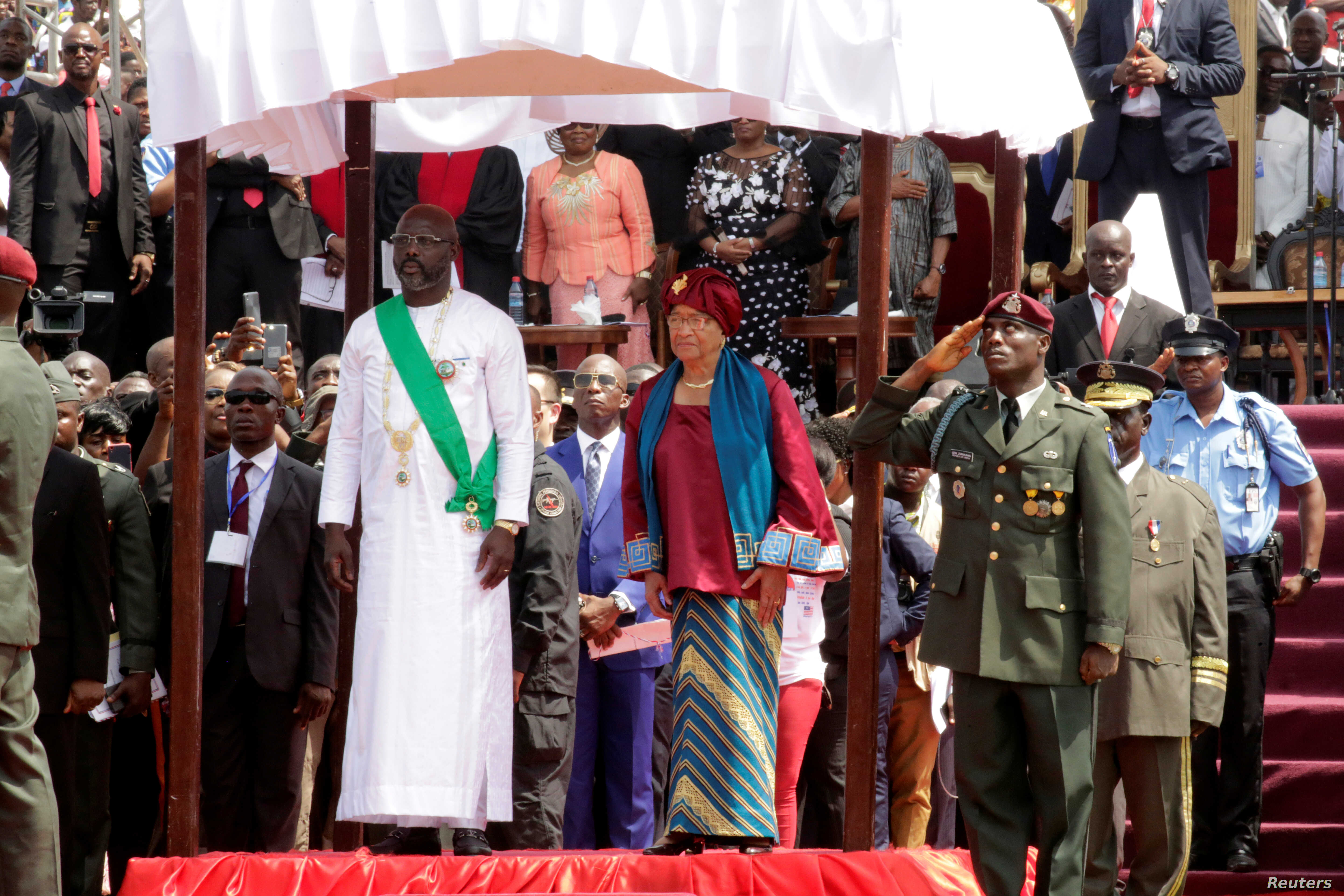 Liberia's former President Ellen Johnson Sirleaf and the new President-elect George Weah are seen during his swearing-in ceremony at Samuel Kanyon Doe Sports Complex in Monrovia, Liberia, Jan. 22, 2018.