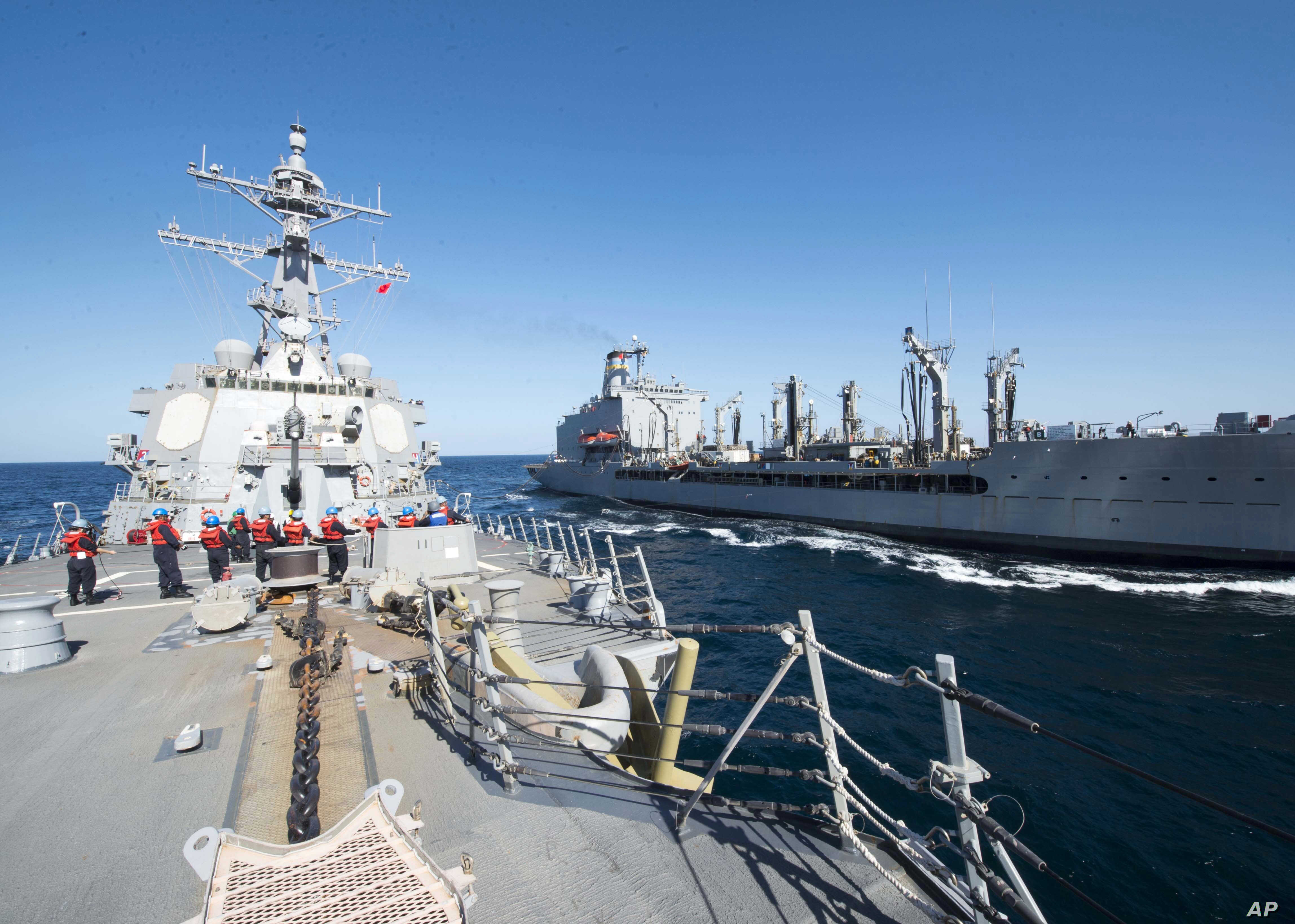 FILE -  U.S. Navy, guided-missile destroyer USS Bulkeley participates in a replenishment-at-sea with fleet replenishment oiler USNS John Lenthall in the Gulf of Oman.