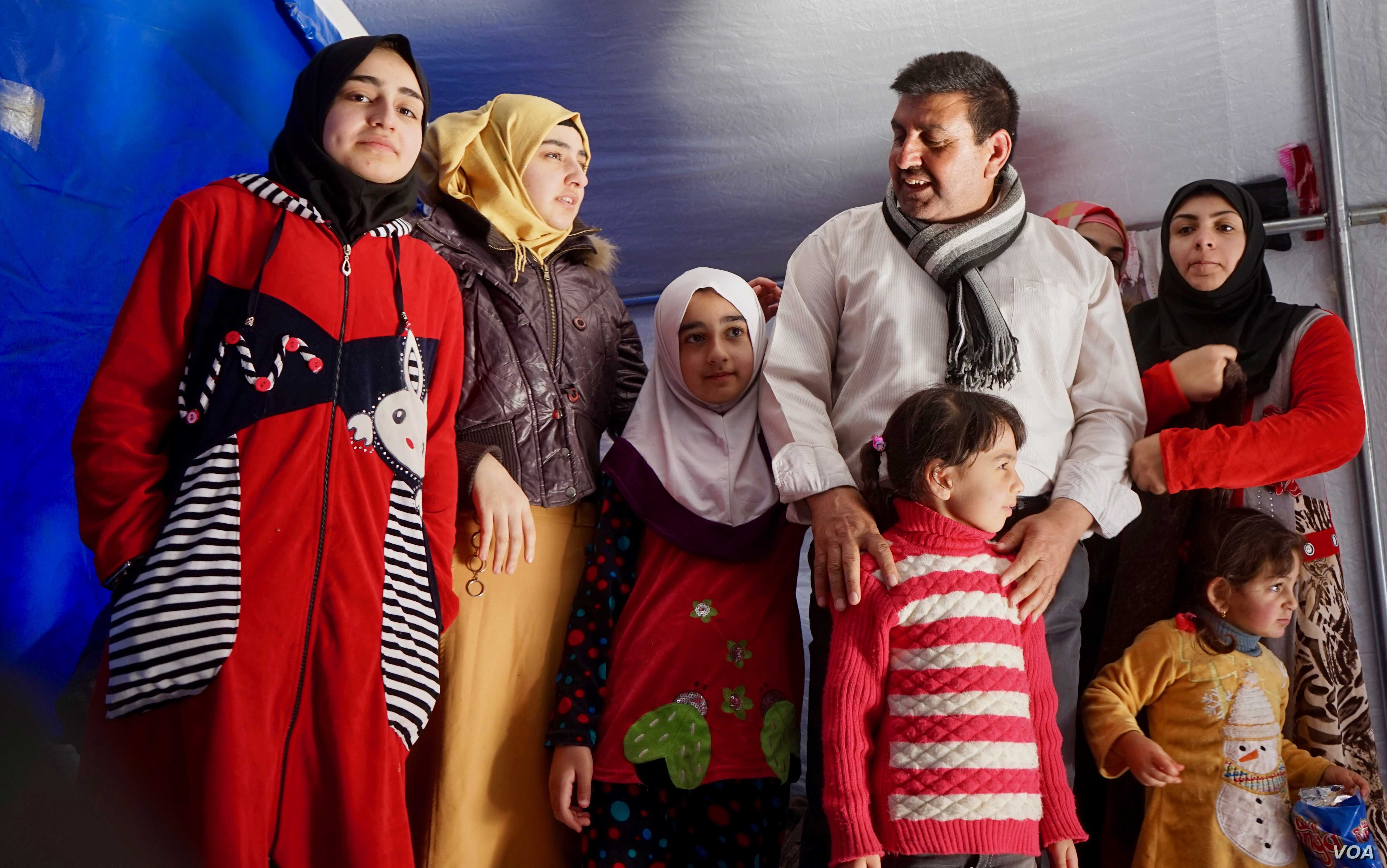 Mohammed and some of his daughters. He shivers when asked what life was like under ISIS in Mosul.
