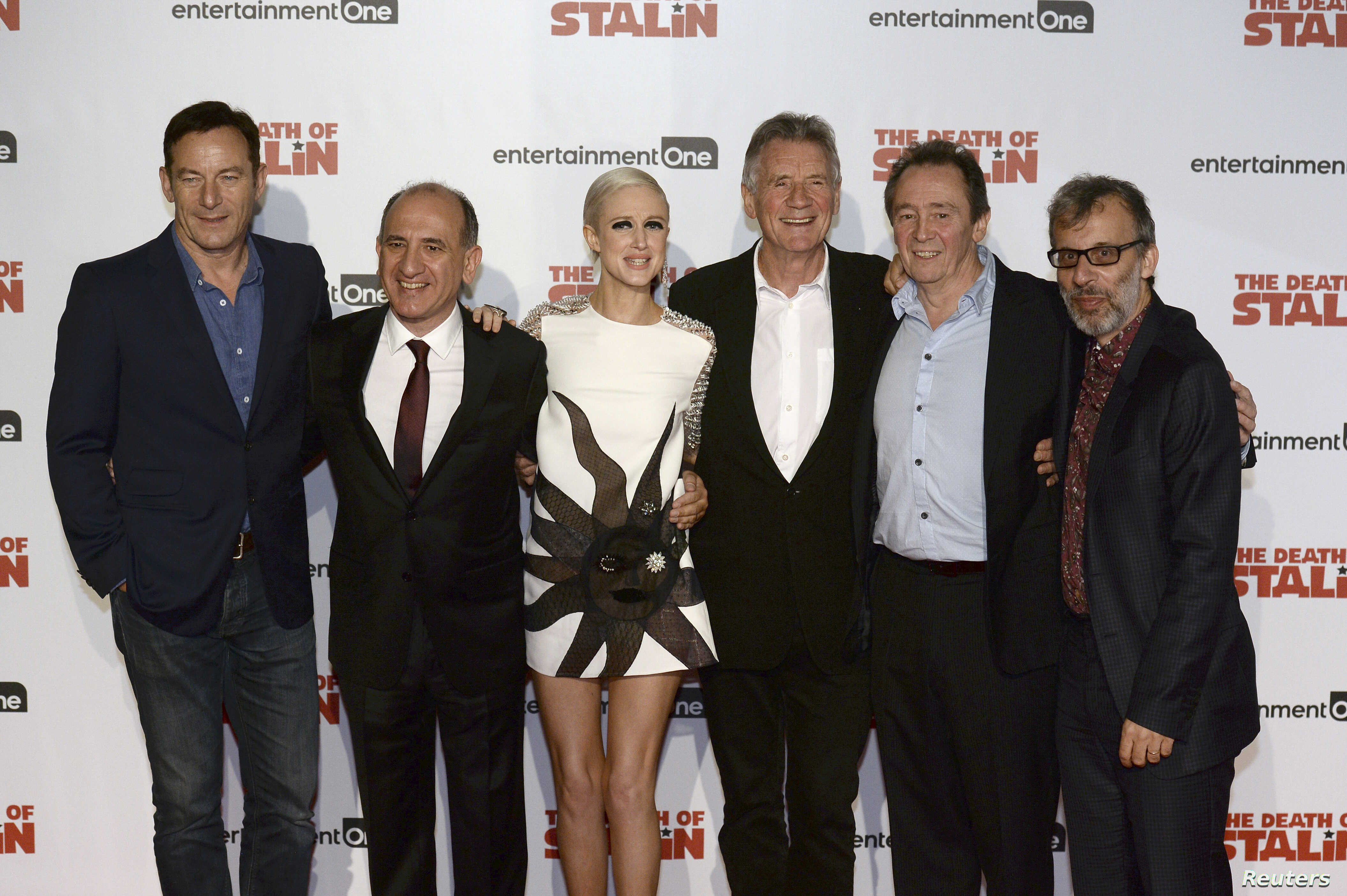 Actor Jason Isaacs, writer and director Armando Iannucci, actors Andrea Riseborough, Michael Palin, Paul Whitehouse and David Schneider  at UK premiere of 'The Death of Stalin', in London, Oct. 17, 2017.