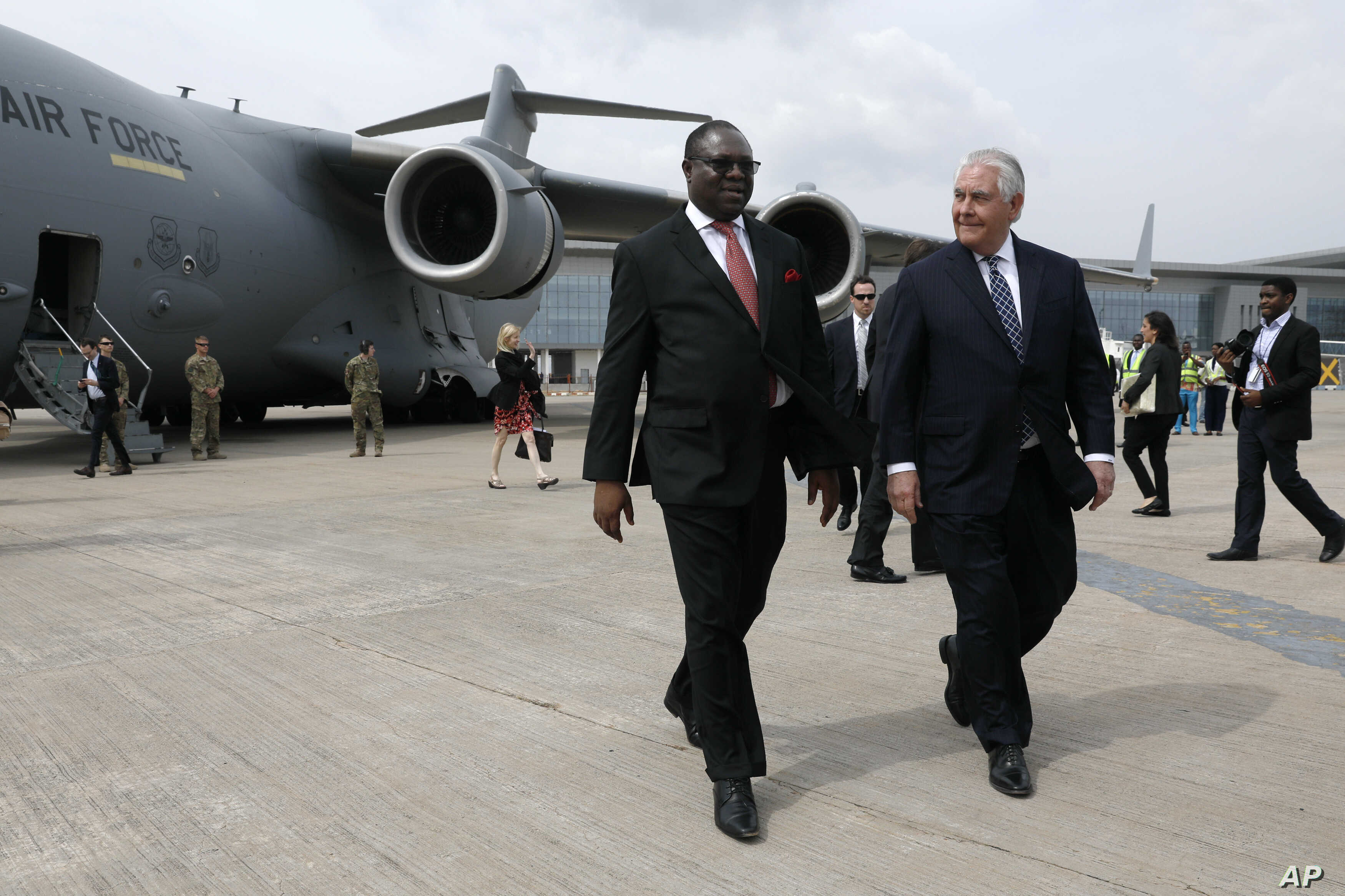 Nigeria's Ministry of Foreign Affairs, the Permanent Secretary Olukunle Bamgbose walks with U.S. Secretary of State Rex Tillerson as he arrives in Abuja, Nigeria, March 12, 2018.