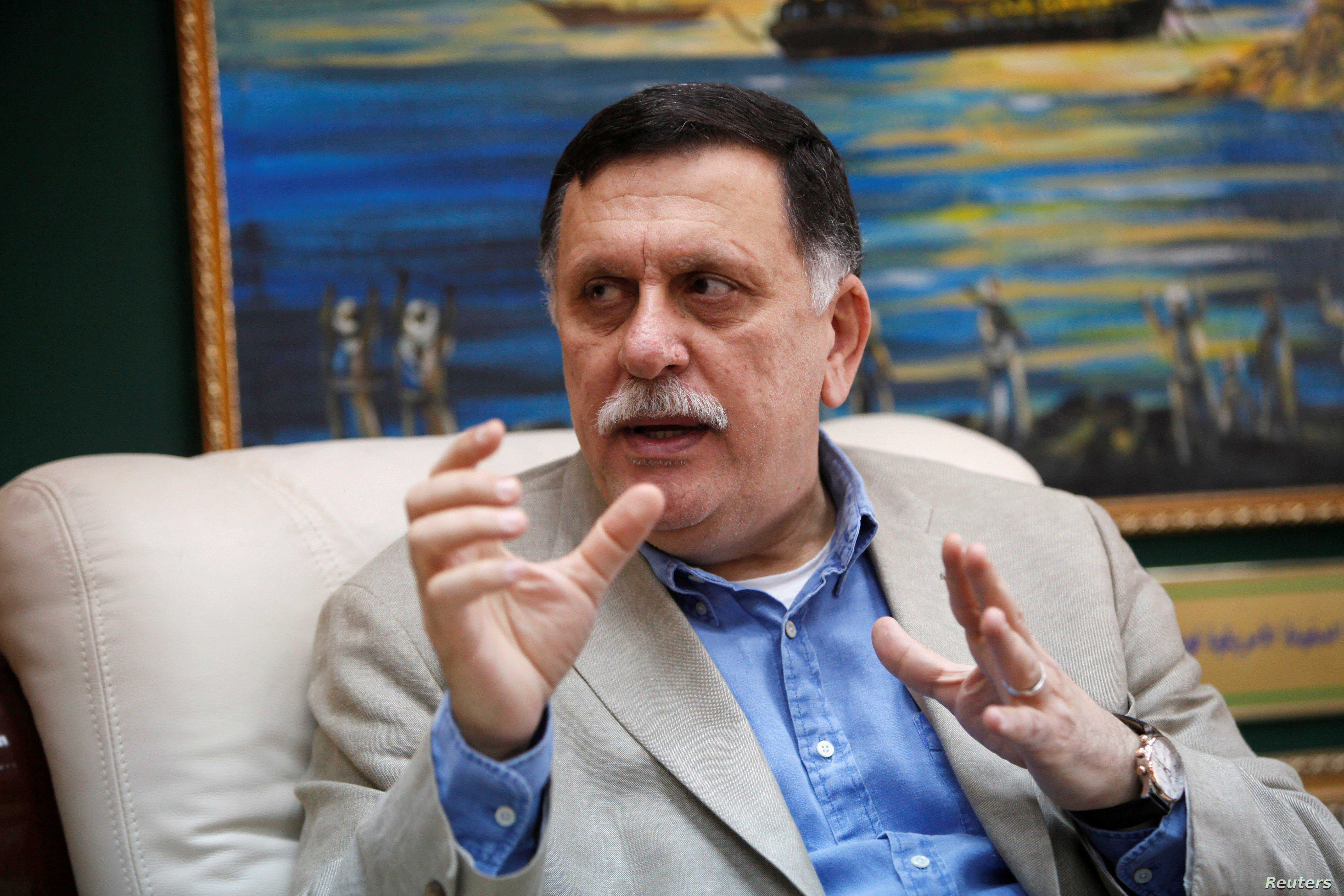 FILE PHOTO: Prime Minister of Libya's unity government Fayez Seraj speaks during an interview with Reuters at his office in the naval base of Tripoli, Libya, June 3, 2016.