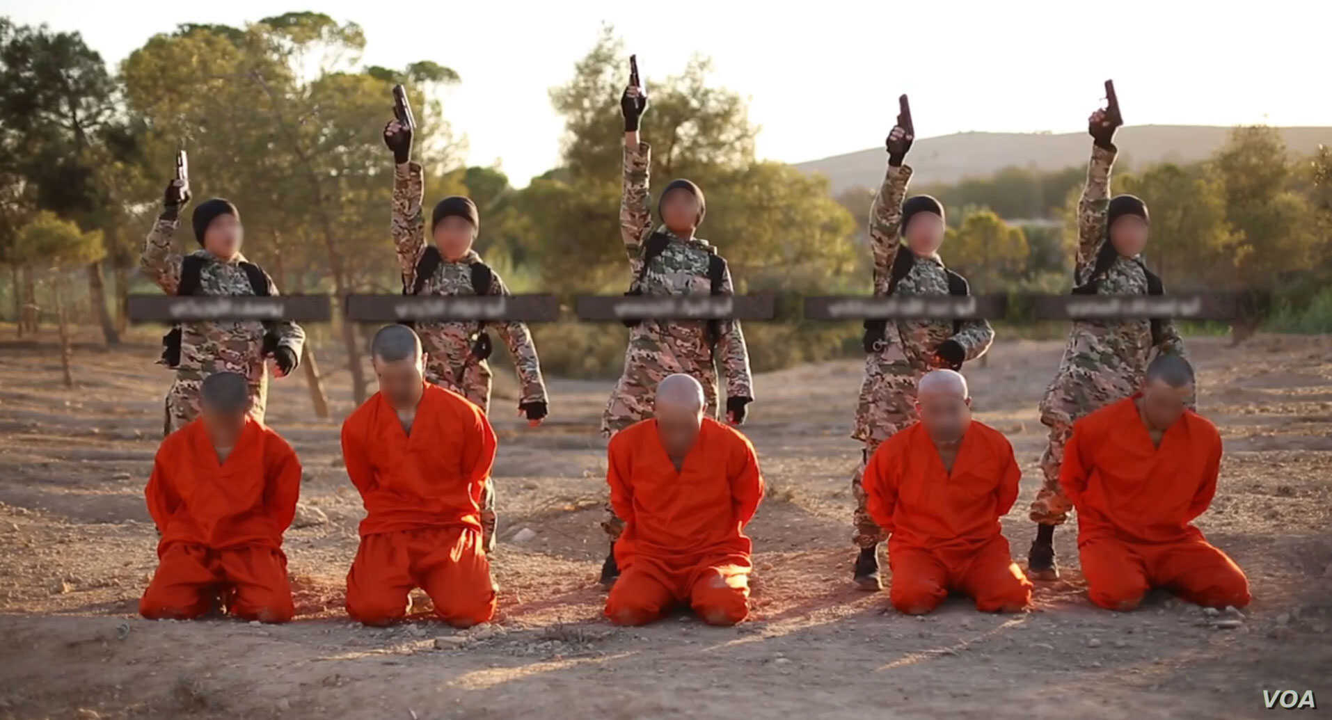 A screenshot from an Islamic State propaganda video that purports to show young boys executing Kurdish fighters.