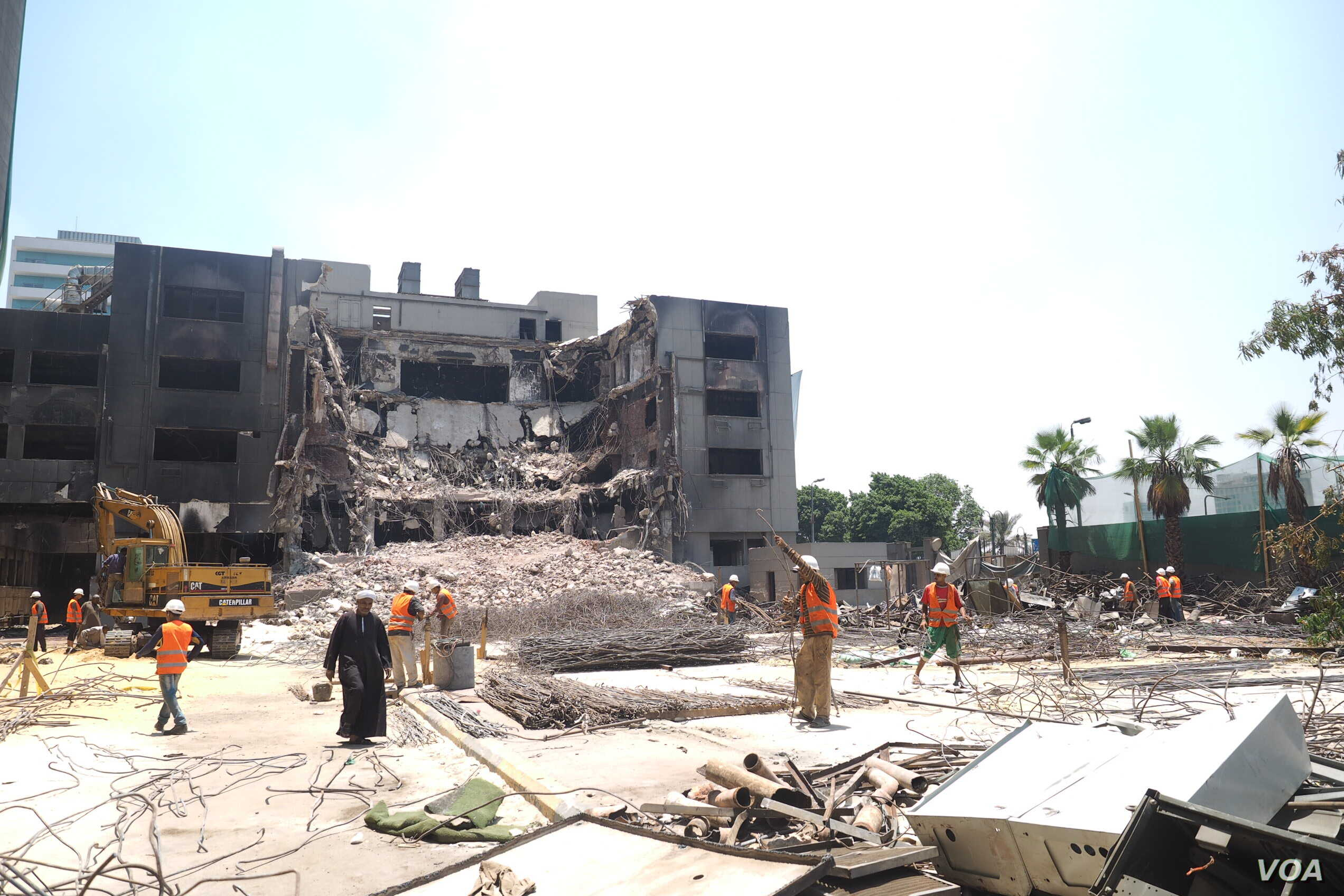Some locals say the destruction of the unused building is a sign of progress, others complain it represents a time of unprecedented idealism in Egypt, Cairo, June 4, 2015.  (H. El Rasam)