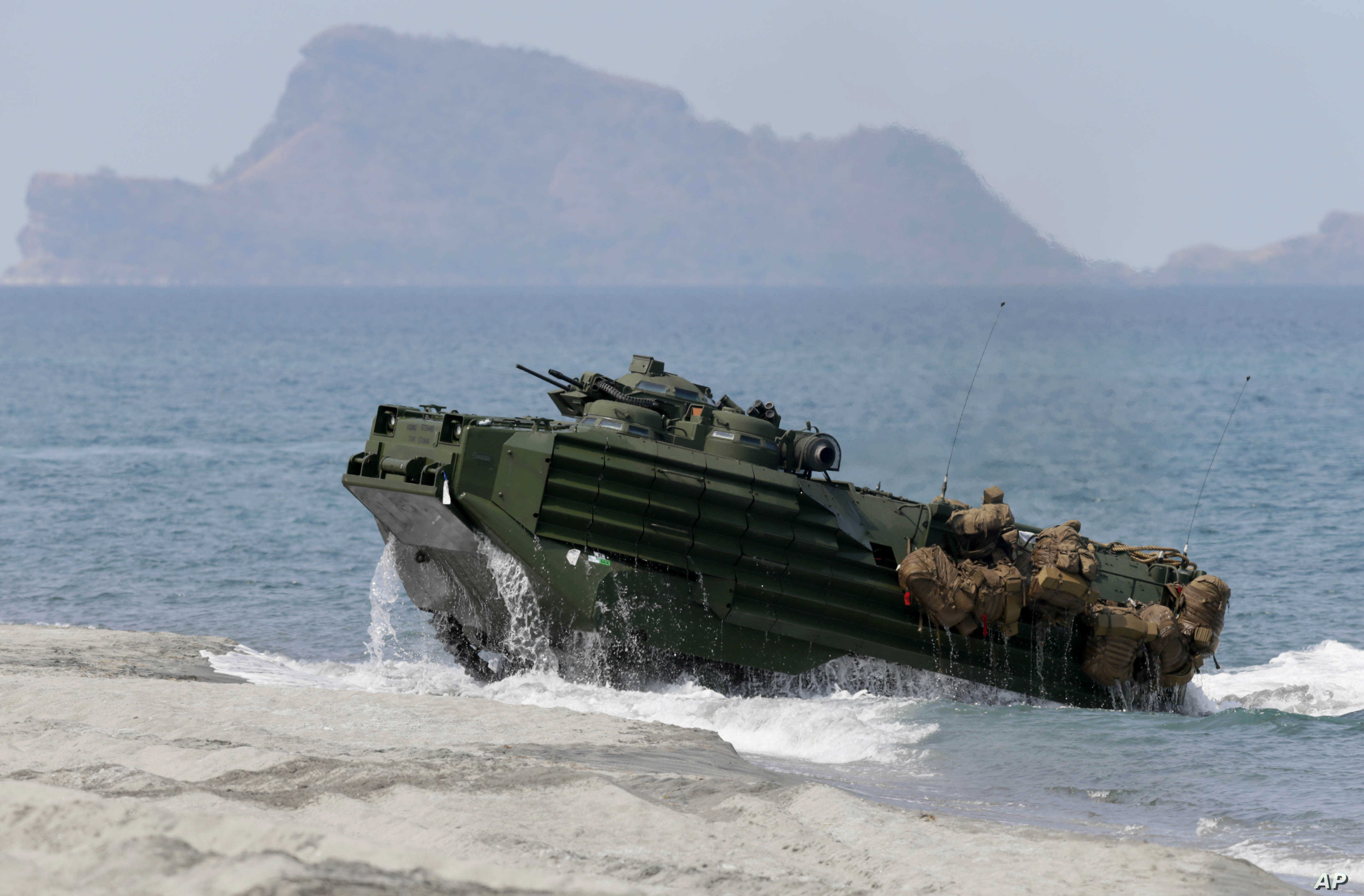 FILE – A U.S. Navy amphibious assault vehicle storms the b