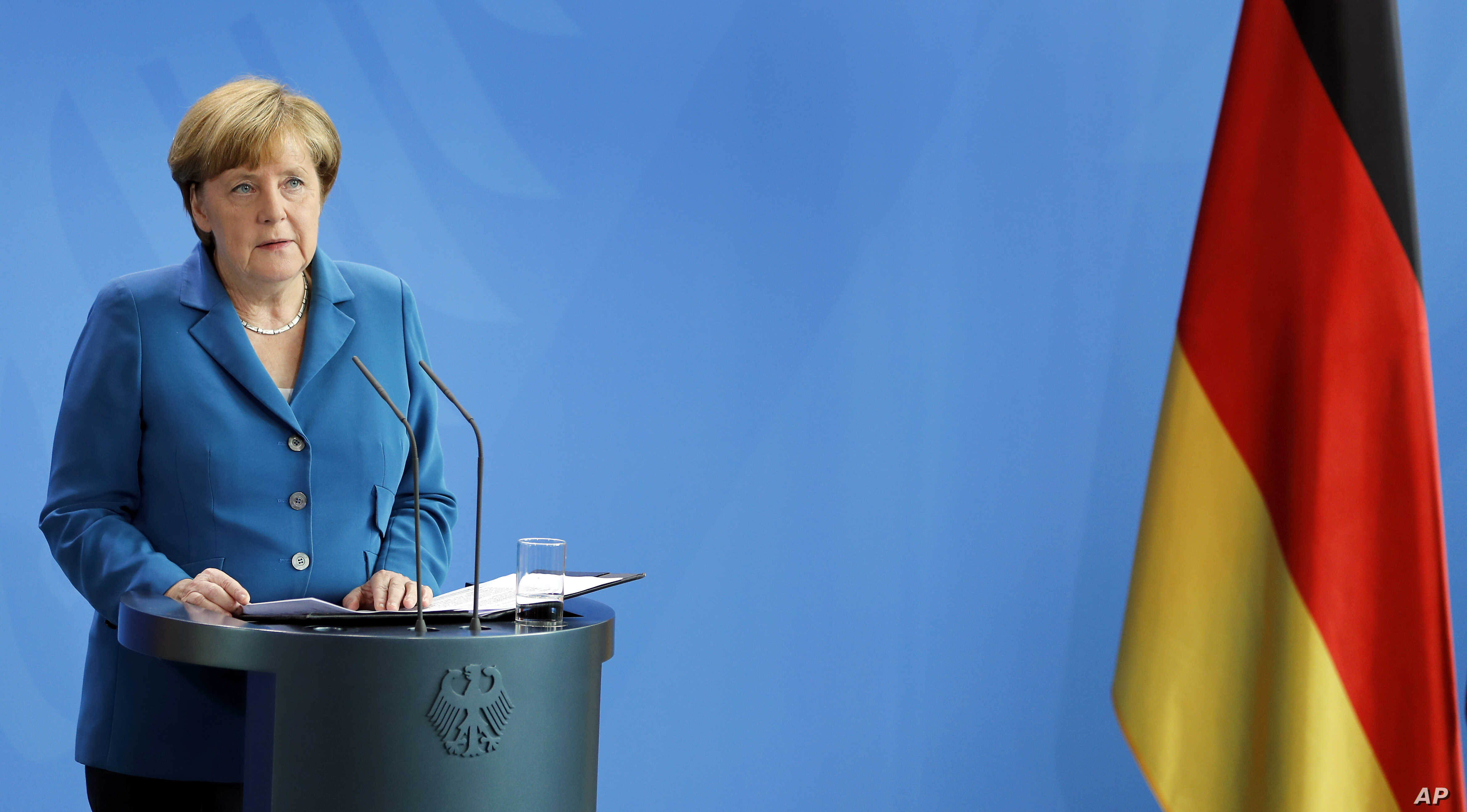 German Chancellor Angela Merkel addresses the media during a statement in Berlin, Germany, Saturday, July 23, 2016 on the Munich attack.