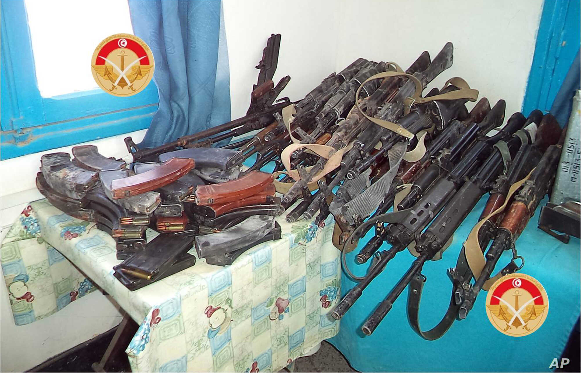 FILE - This photo taken Monday, Match 7, 2016 and provided by the Tunisian Defense Minister on Tuesday, March 8, 2016 shows weapons seized by Tunisian forces from militants in the city of Ben Guerdane, southern Tunisia. (Tunisian Defense Ministry via...