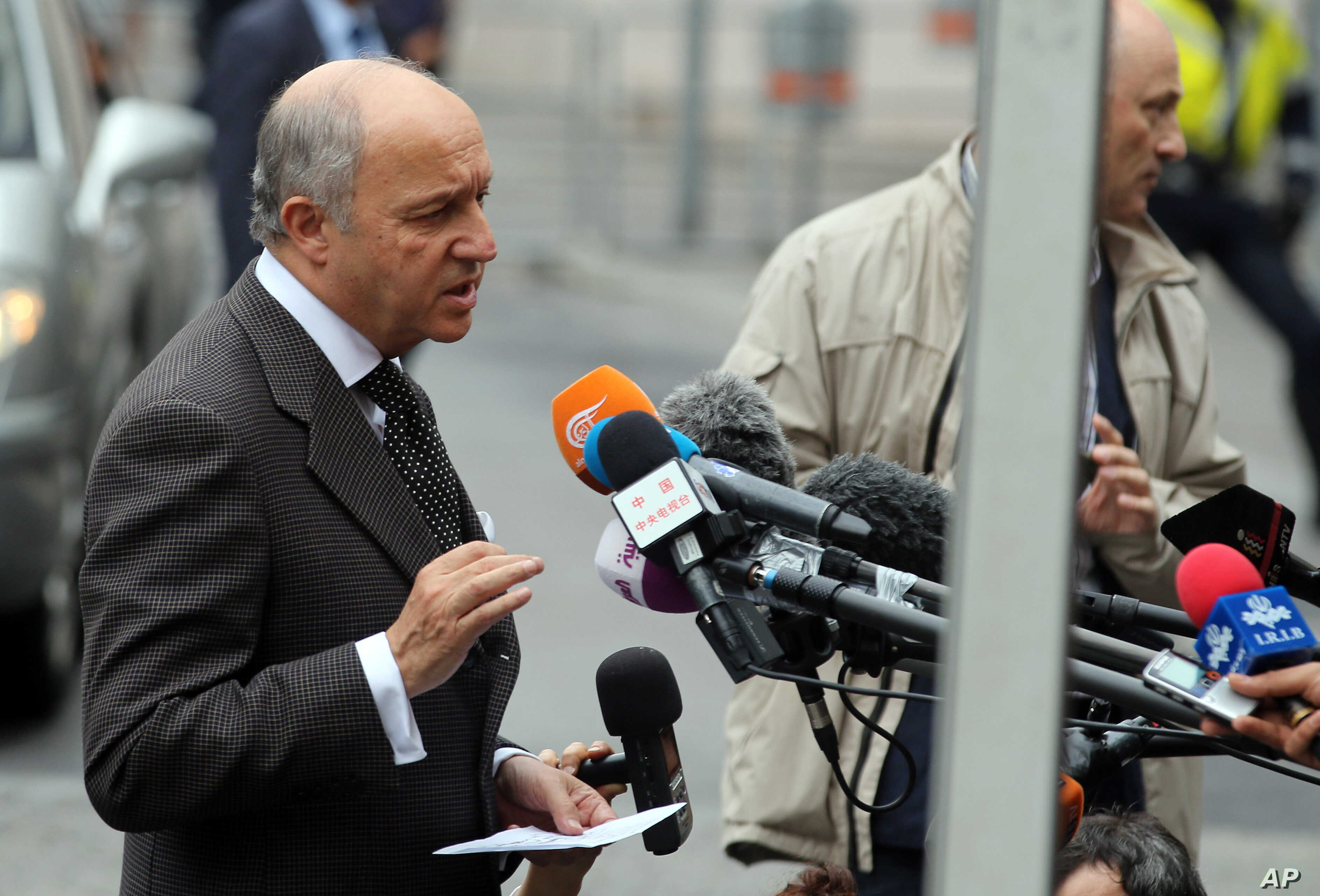 French Foreign Minister Laurent Fabius talks to media as he arrives at Palais Coburg where closed-door nuclear talks with Iran take place in Vienna, Austria, June 27, 2015.