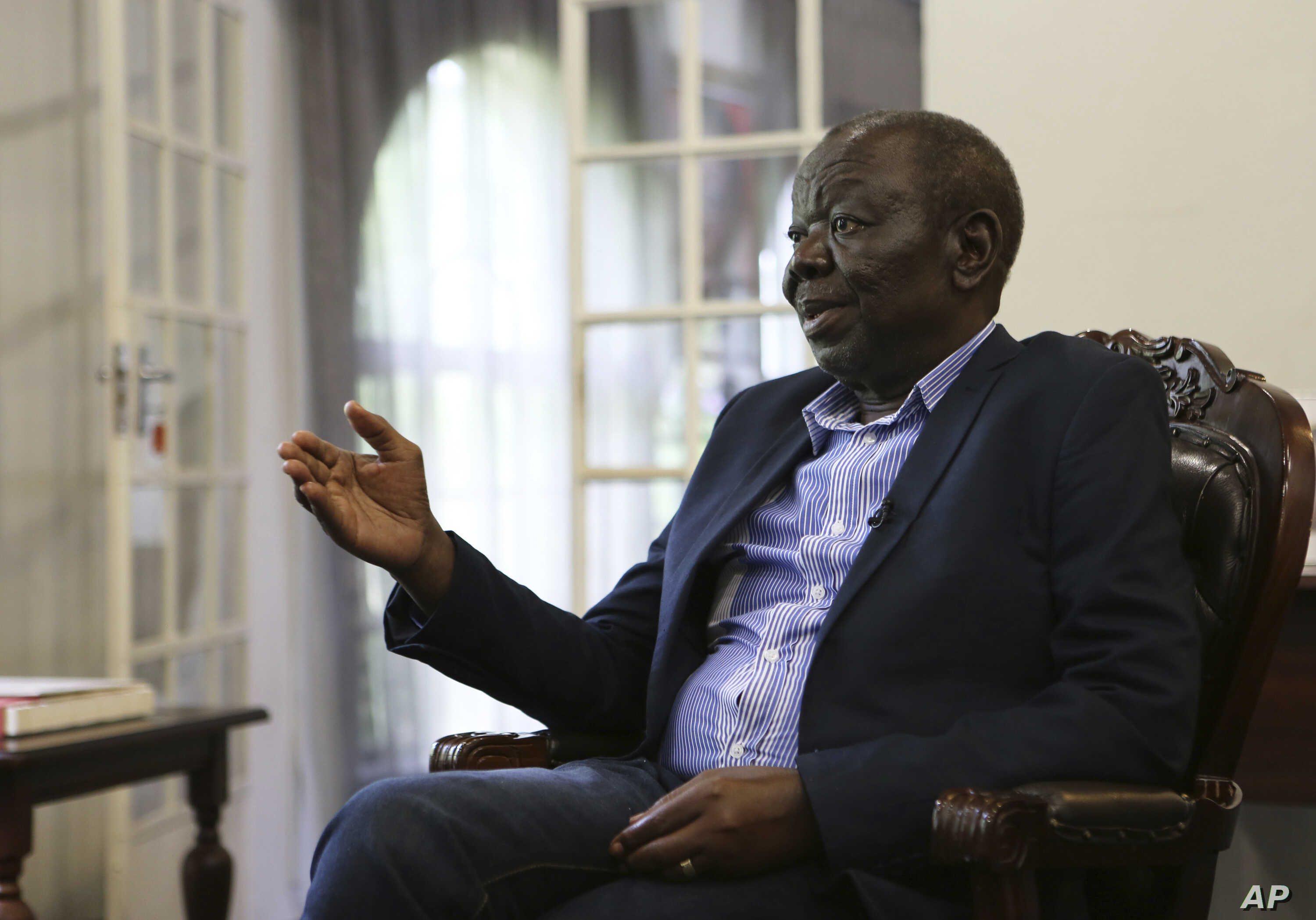 FILE - Zimbabwe's main opposition leader Morgan Tsvangirai stresses a point during an interview with the Associated Press at his home in Harare.