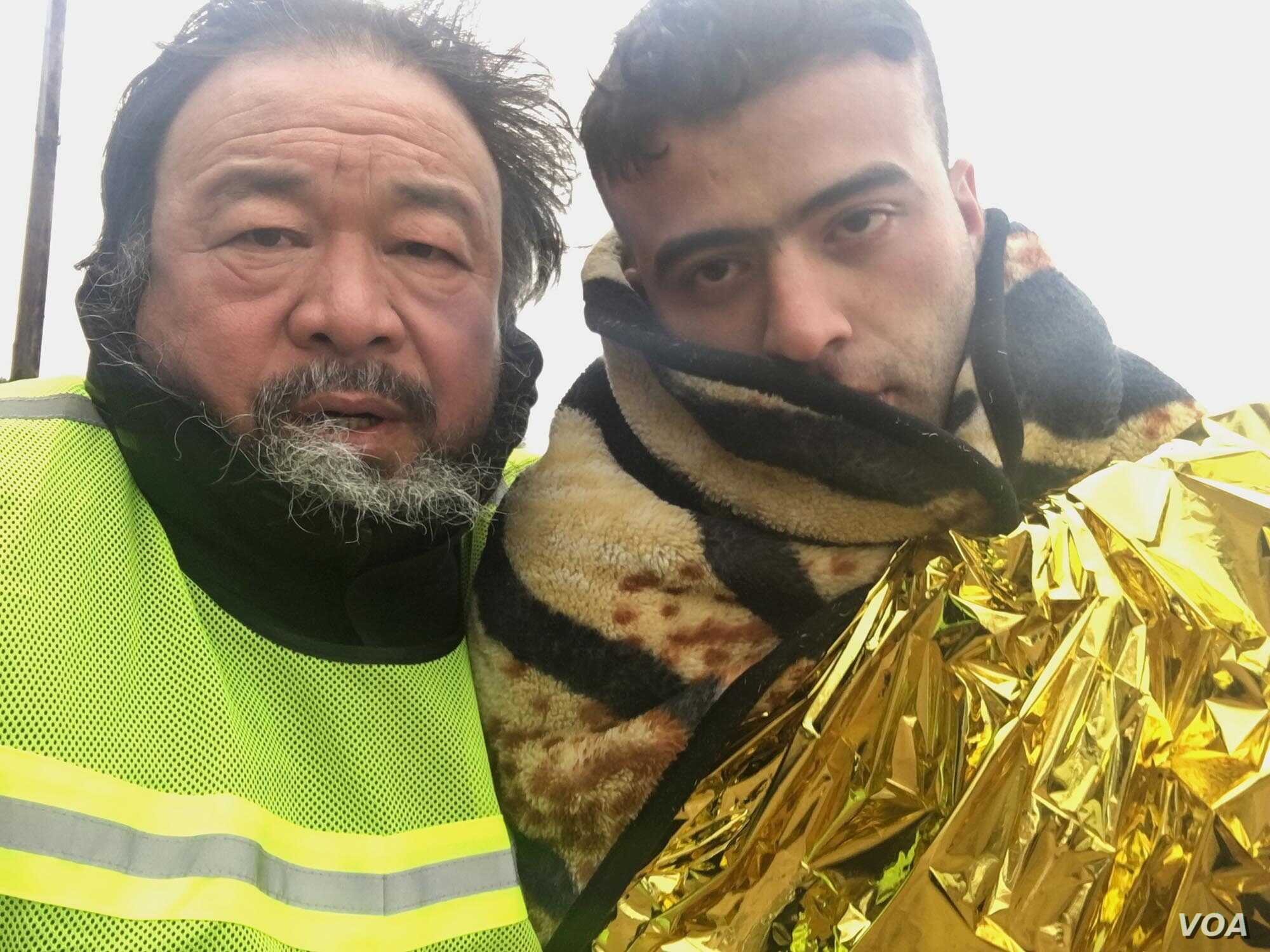Ai Weiwei with refugee in scene from 'Human Flow' documentary.