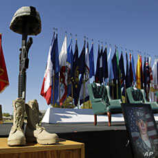 A soldier's memorial and photos are seen during a Remembrance Ceremony commemorating the one-year anniversary of the worst mass shooting on a U.S. military base, where 13 people were killed and dozens wounded, Friday, Nov. 5, 2010, in Fort Hood. (AP ...
