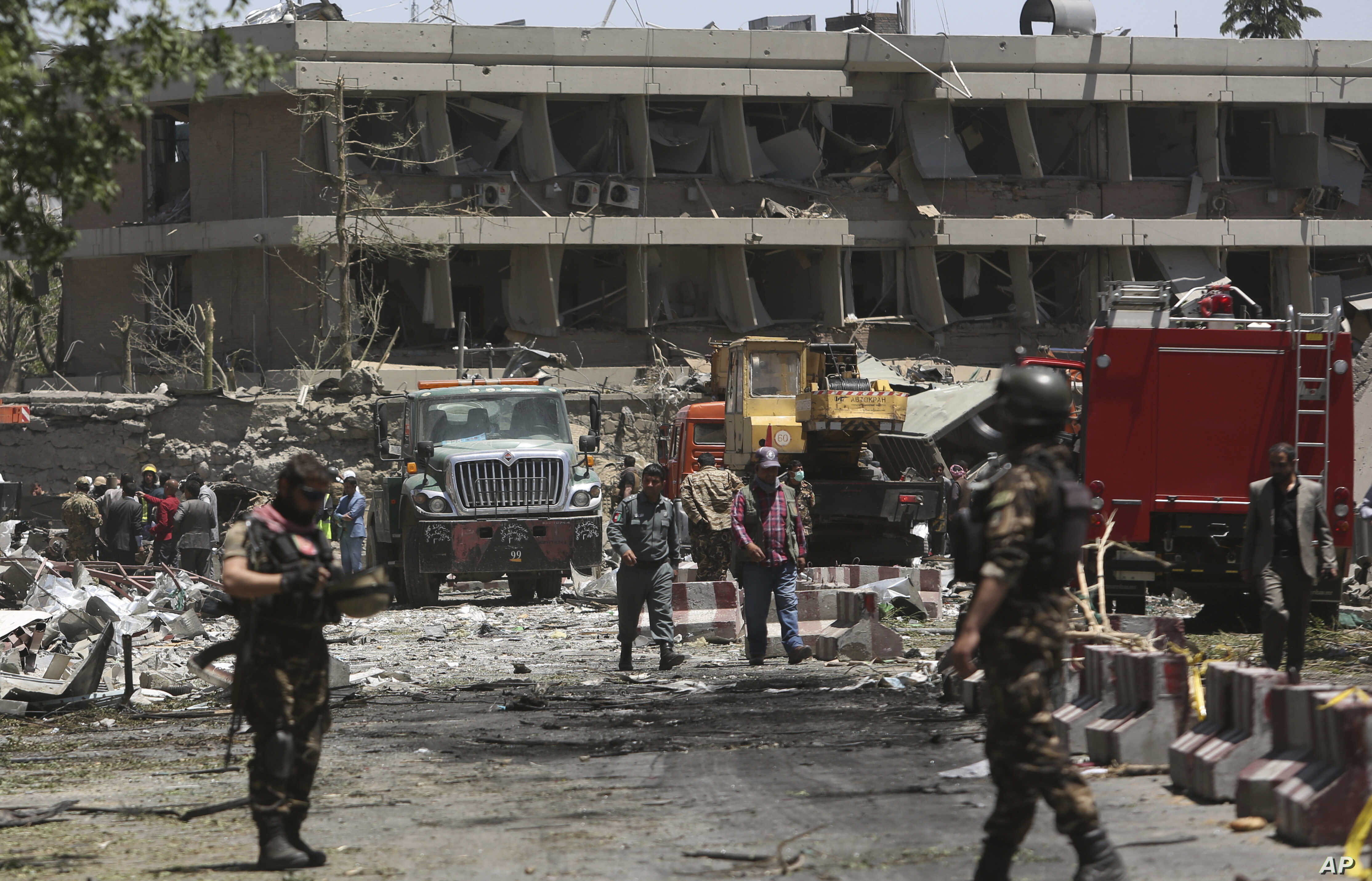 FILE - Security forces inspect the site of a massive suicide attack that killed more than 150, according to the Afghan president, in front of the German Embassy in Kabul, Afghanistan, May 31,2017. A letter by a senior Islamic State militant points to...