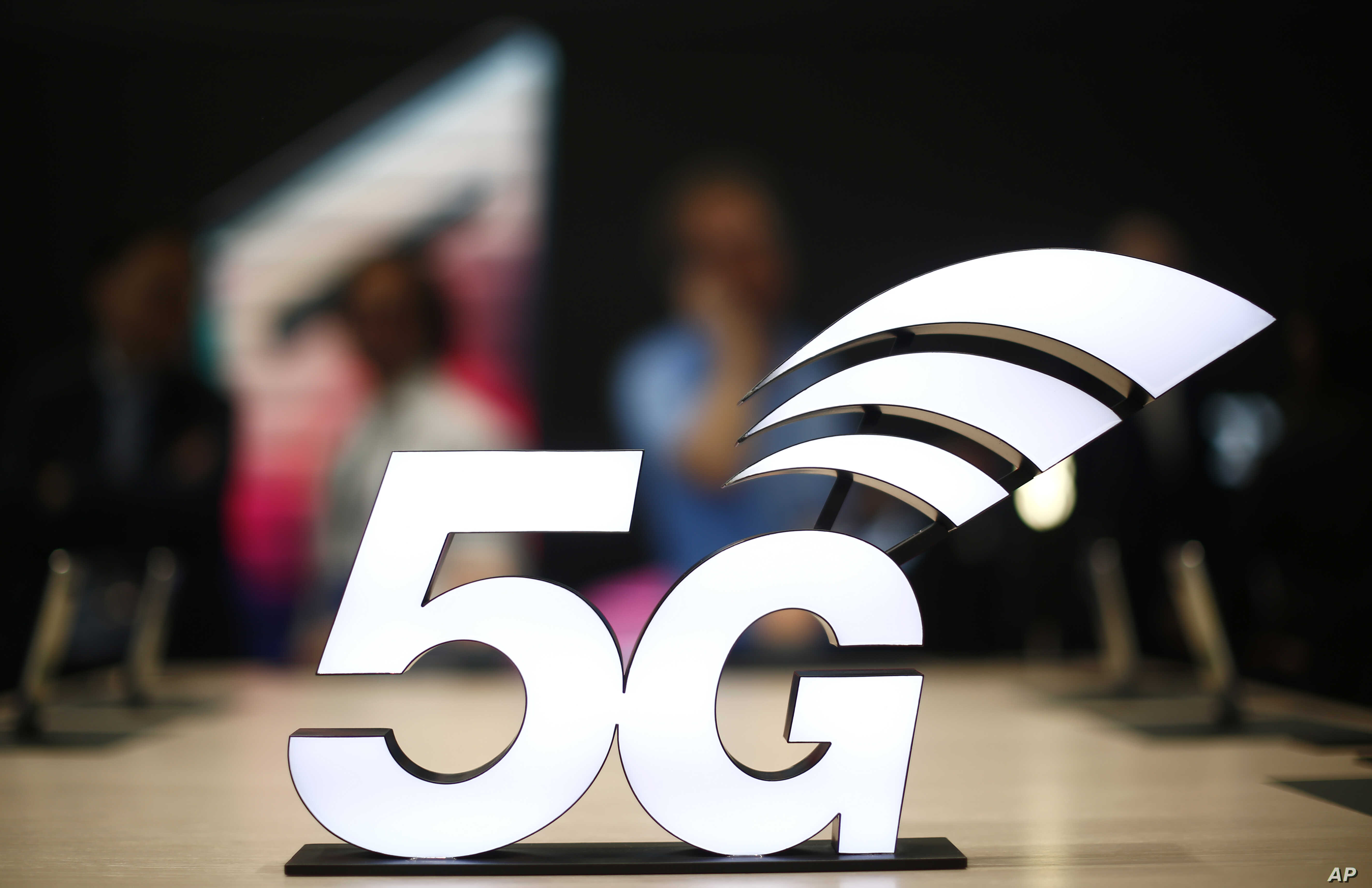 A banner of the 5G network is displayed during the Mobile World Congress wireless show, in Barcelona, Spain, Feb. 25, 2019.